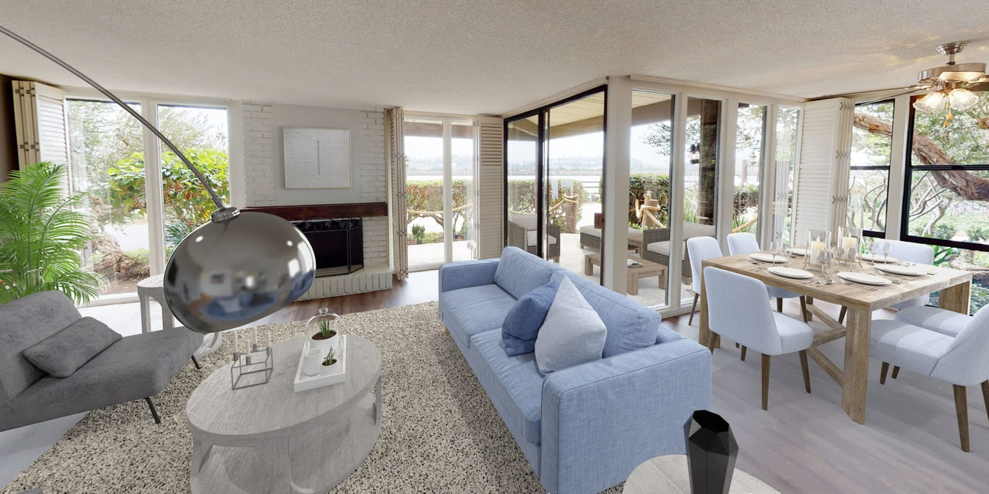 Fireplace and plush carpeting in the living area of a luxury three-bedroom apartment at Mariners Village in Marina del Rey, California