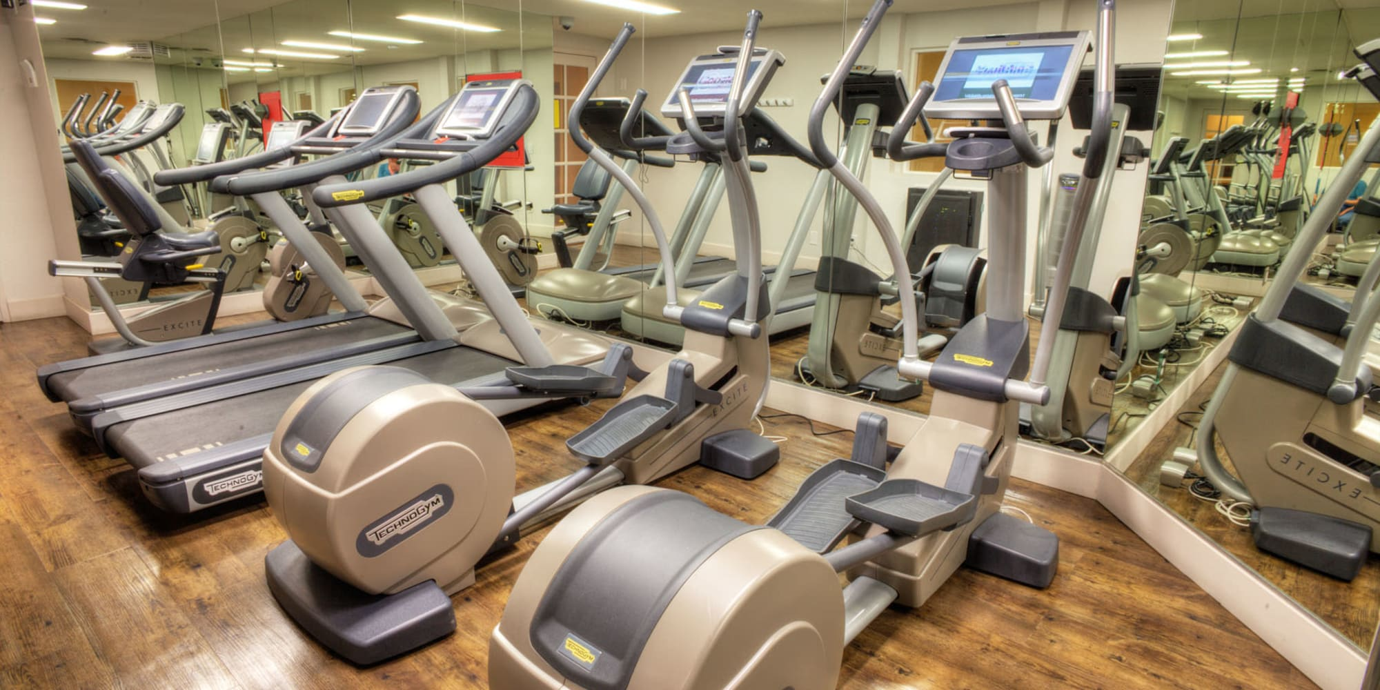 Well-equipped fitness center with ample cardio equipment at Sunset Barrington Gardens in Los Angeles, California