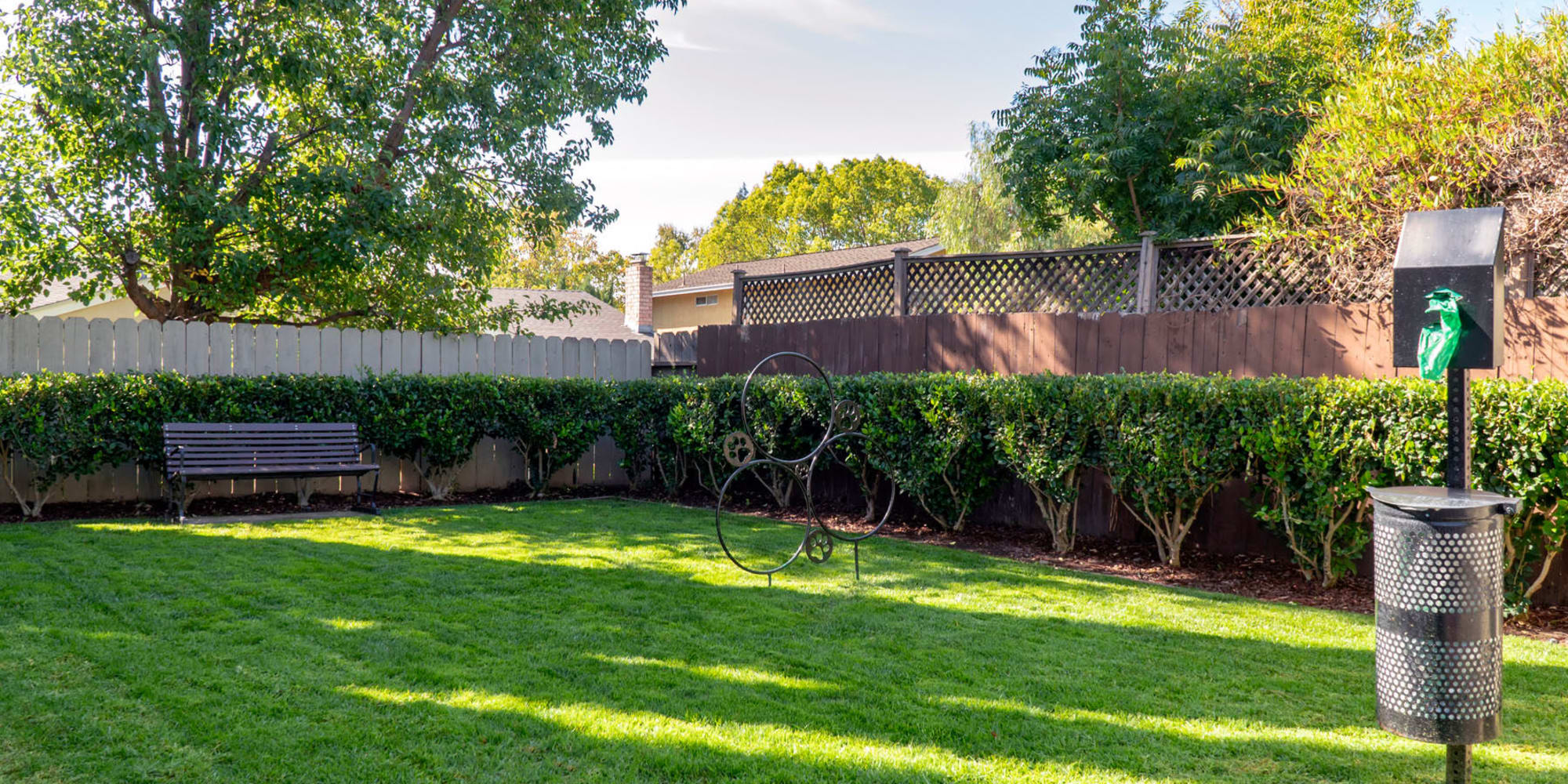 Green grass for your dog to play on at the onsite bark park at Pleasanton Place Apartment Homes in Pleasanton, California