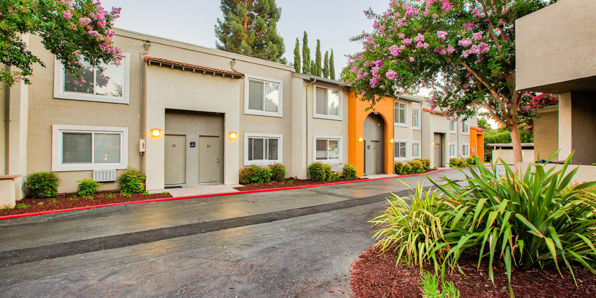 Resident buildings and immaculately maintained grounds at Pleasanton Place Apartment Homes in Pleasanton, California