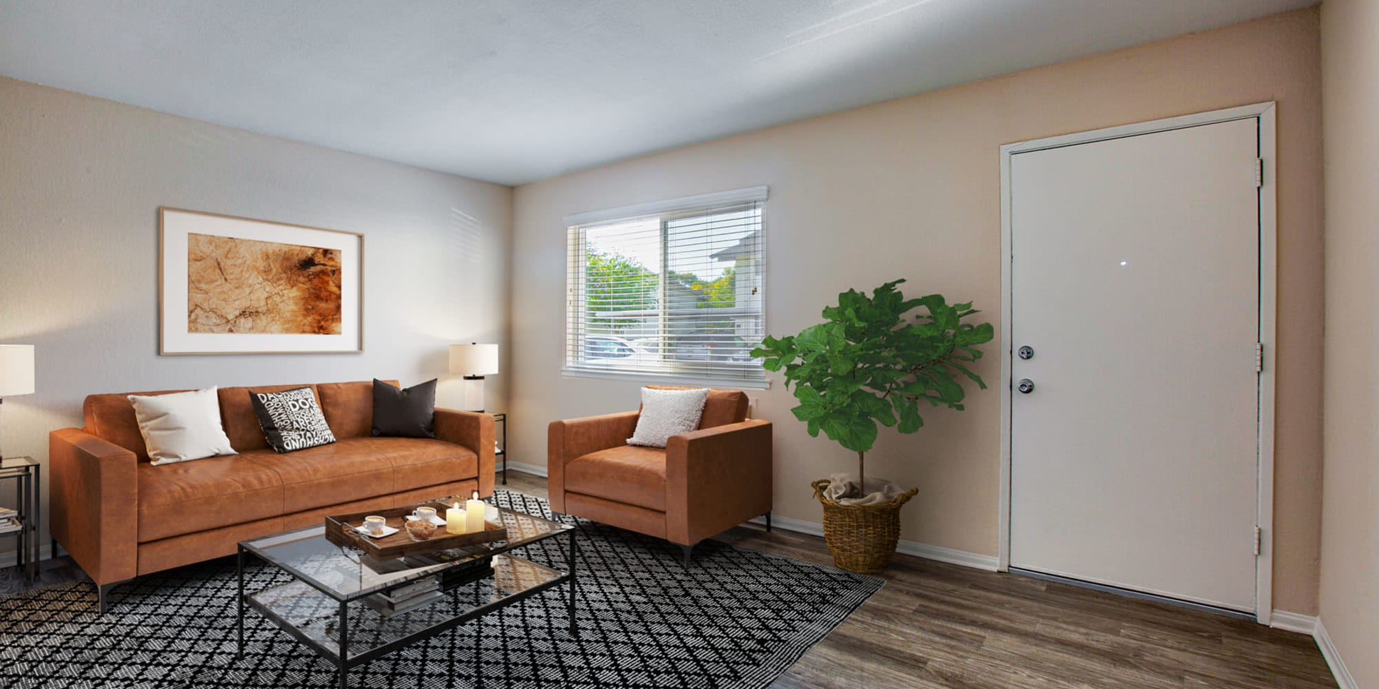 Modern furnishings in the living area of a model apartment at Pleasanton Place Apartment Homes in Pleasanton, California