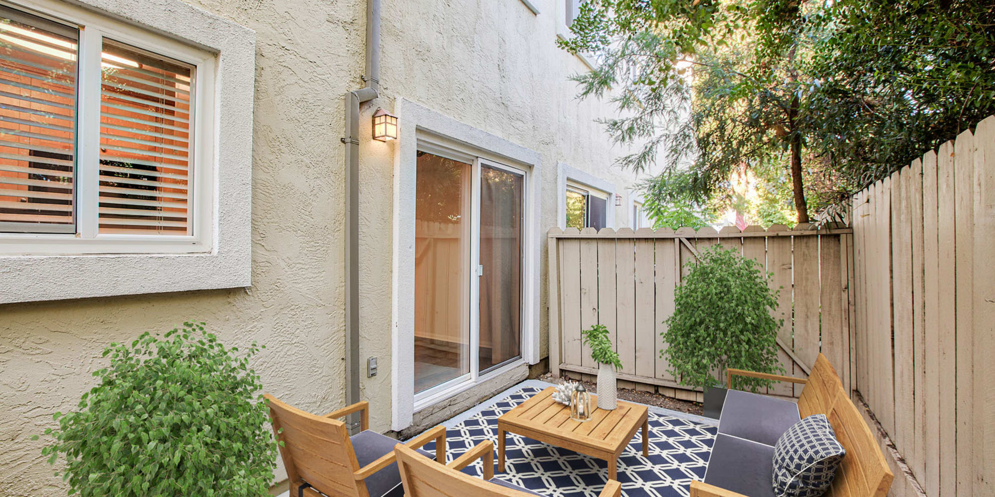 Model home's well-furnished private patio at Pleasanton Place Apartment Homes in Pleasanton, California