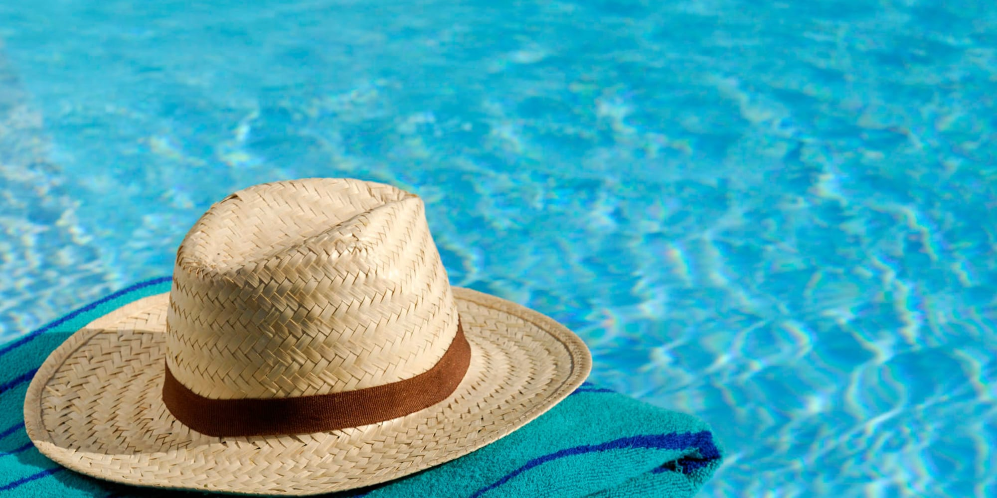 Sun hat and towel next to the swimming pool at Parkwood in Lancaster, California