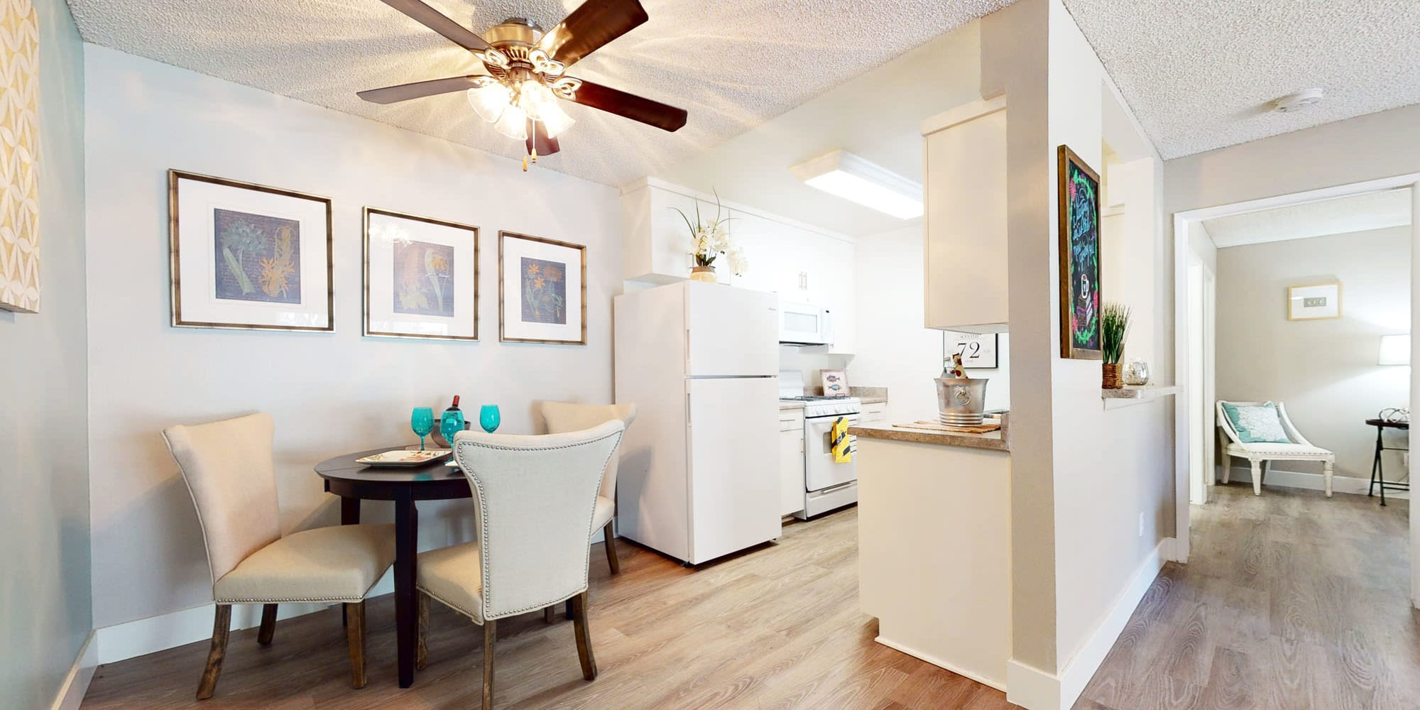 Ceiling fan above the dining nook next to the kitchen in a model apartment at Mountain Vista in Victorville, California