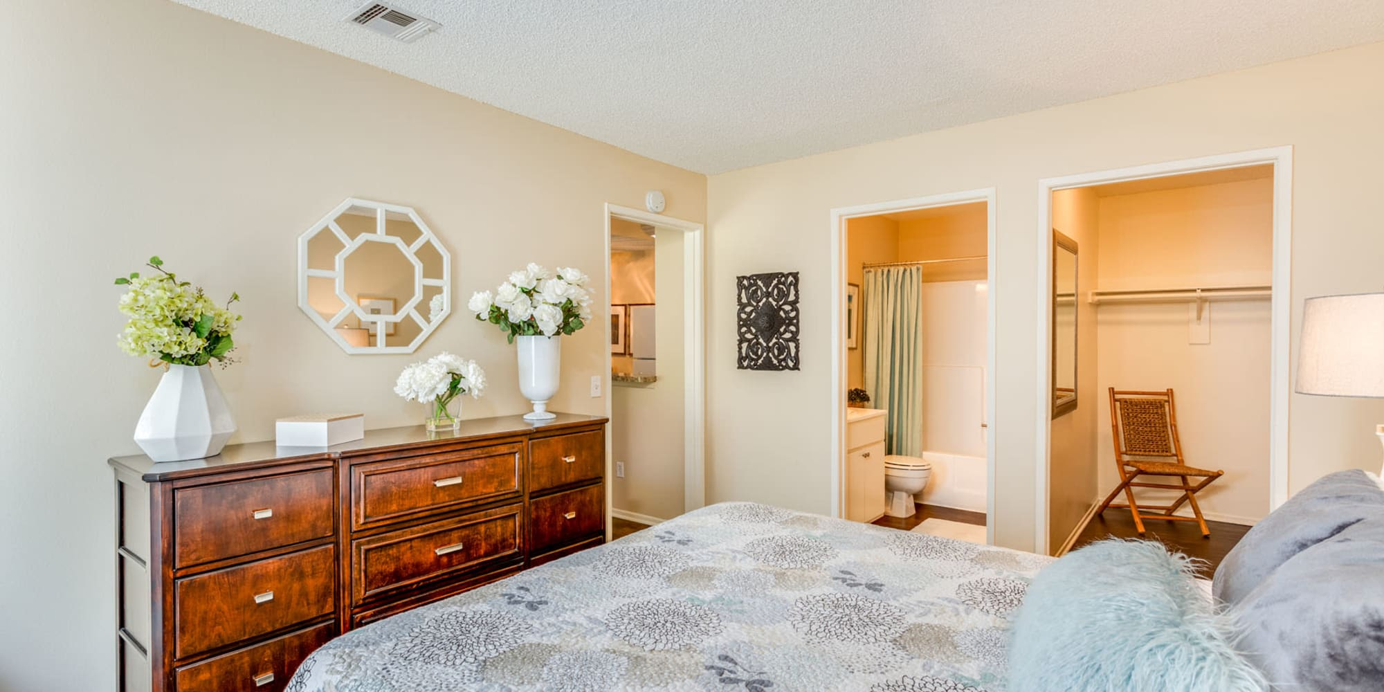 Spacious primary bedroom with an en suite bathroom and walk-in closet at Mountain Vista in Victorville, California
