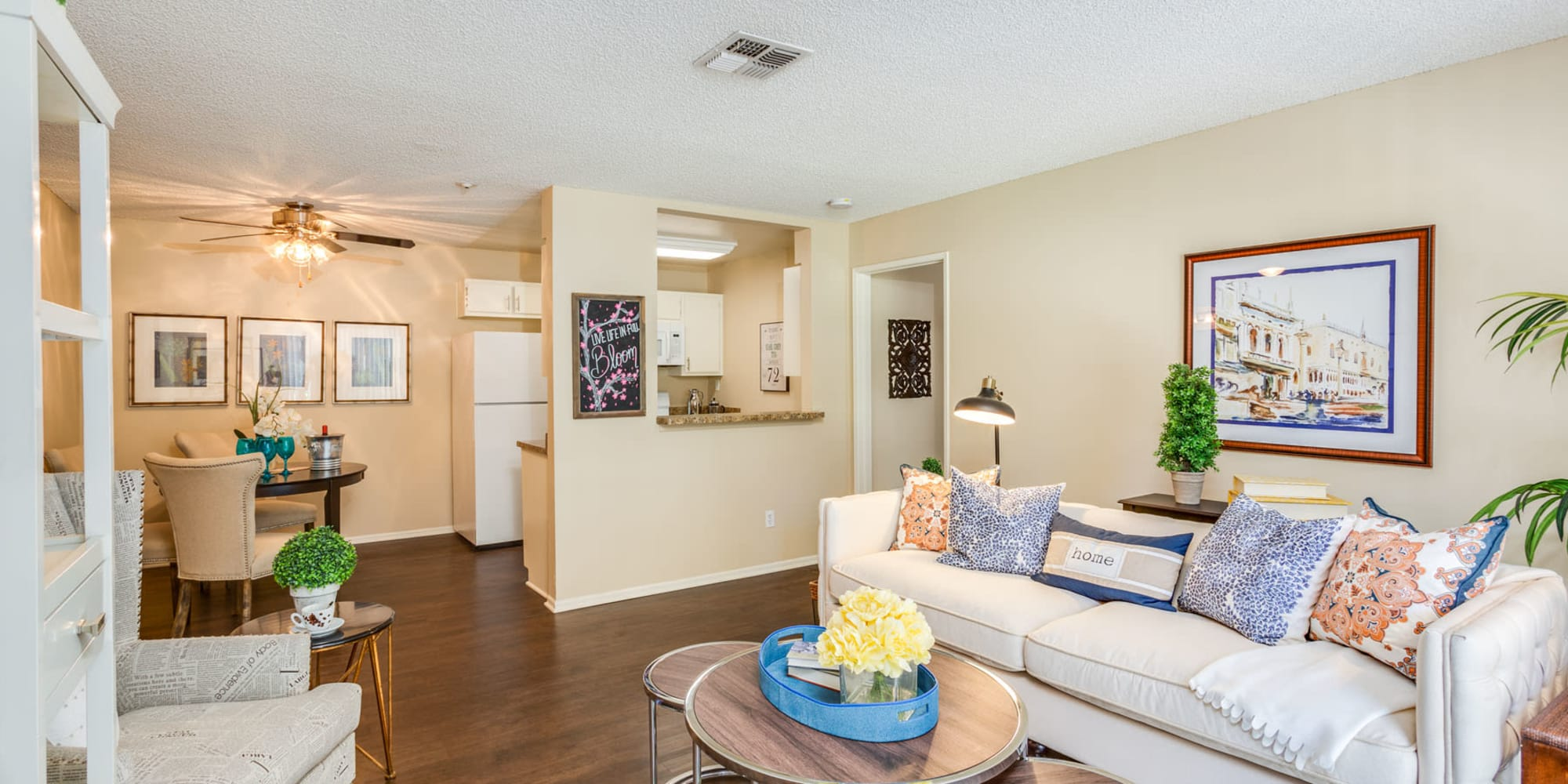 Open-concept living area with beautiful hardwood flooring in a model home at Mountain Vista in Victorville, California