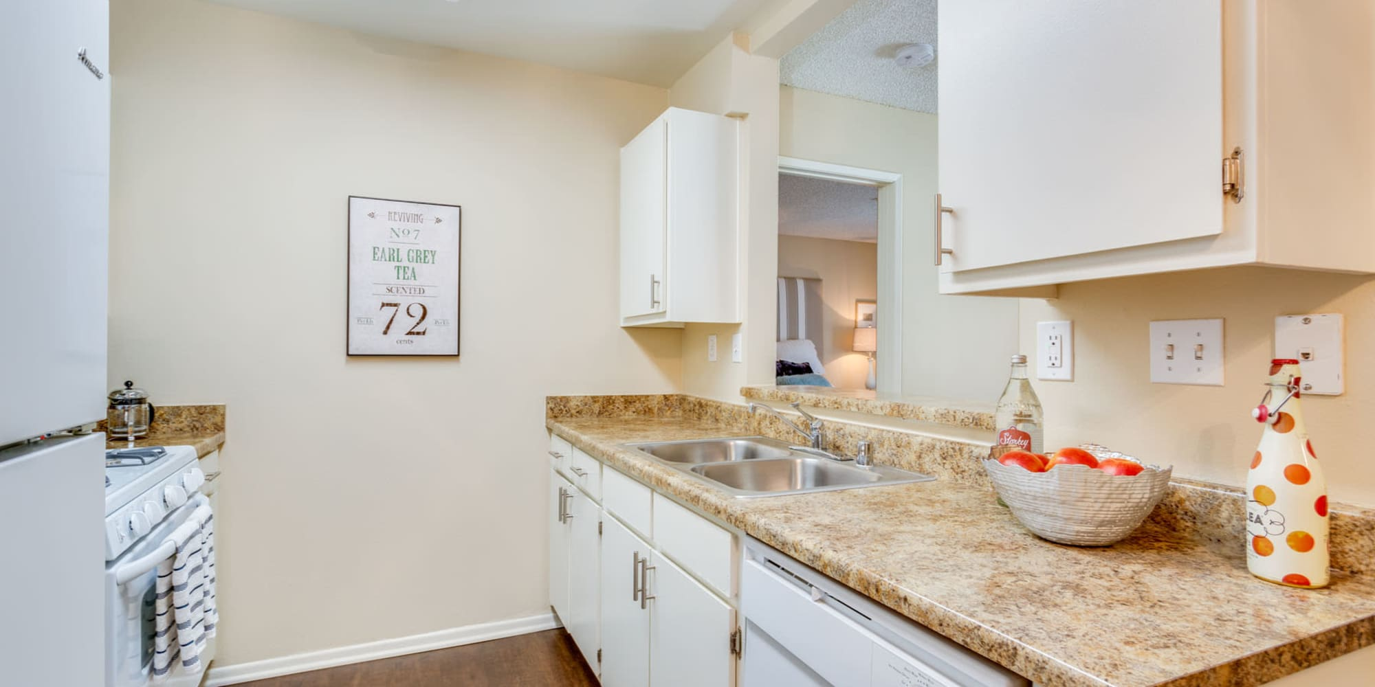 Model home's kitchen with ample cupboard space for storage at Mountain Vista in Victorville, California