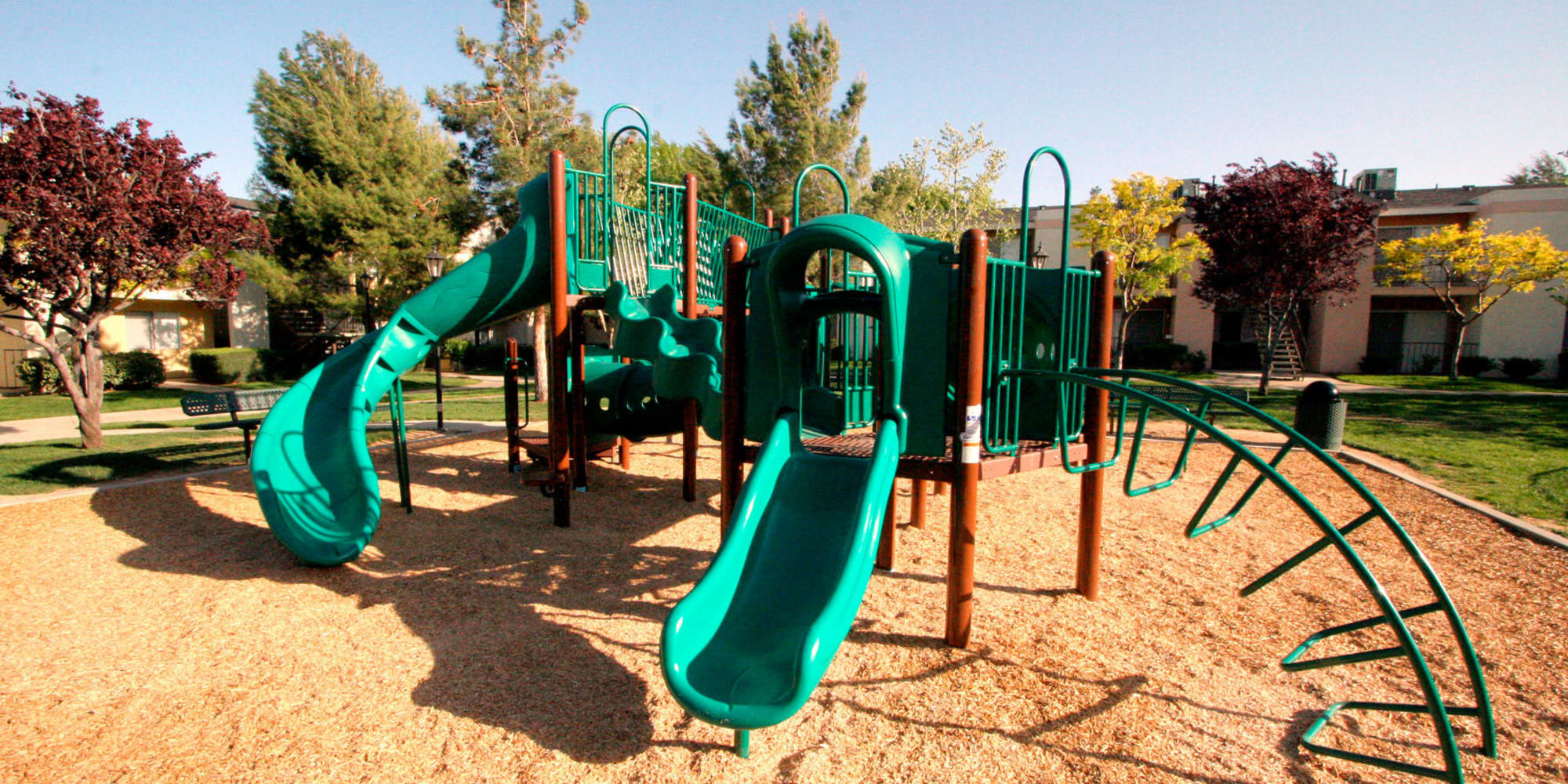 Expansive onsite children's playground at Mountain Vista in Victorville, California