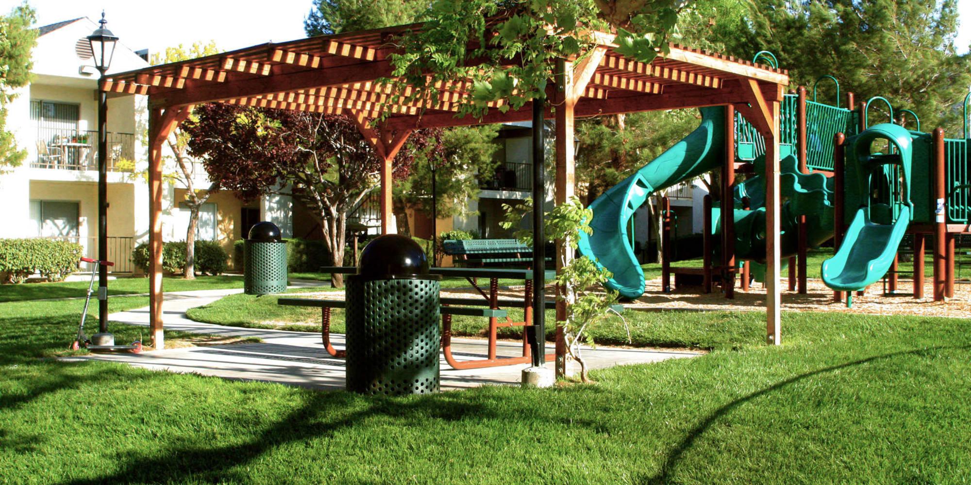 Pergola over a picnic area near the children's playground at Mountain Vista in Victorville, California