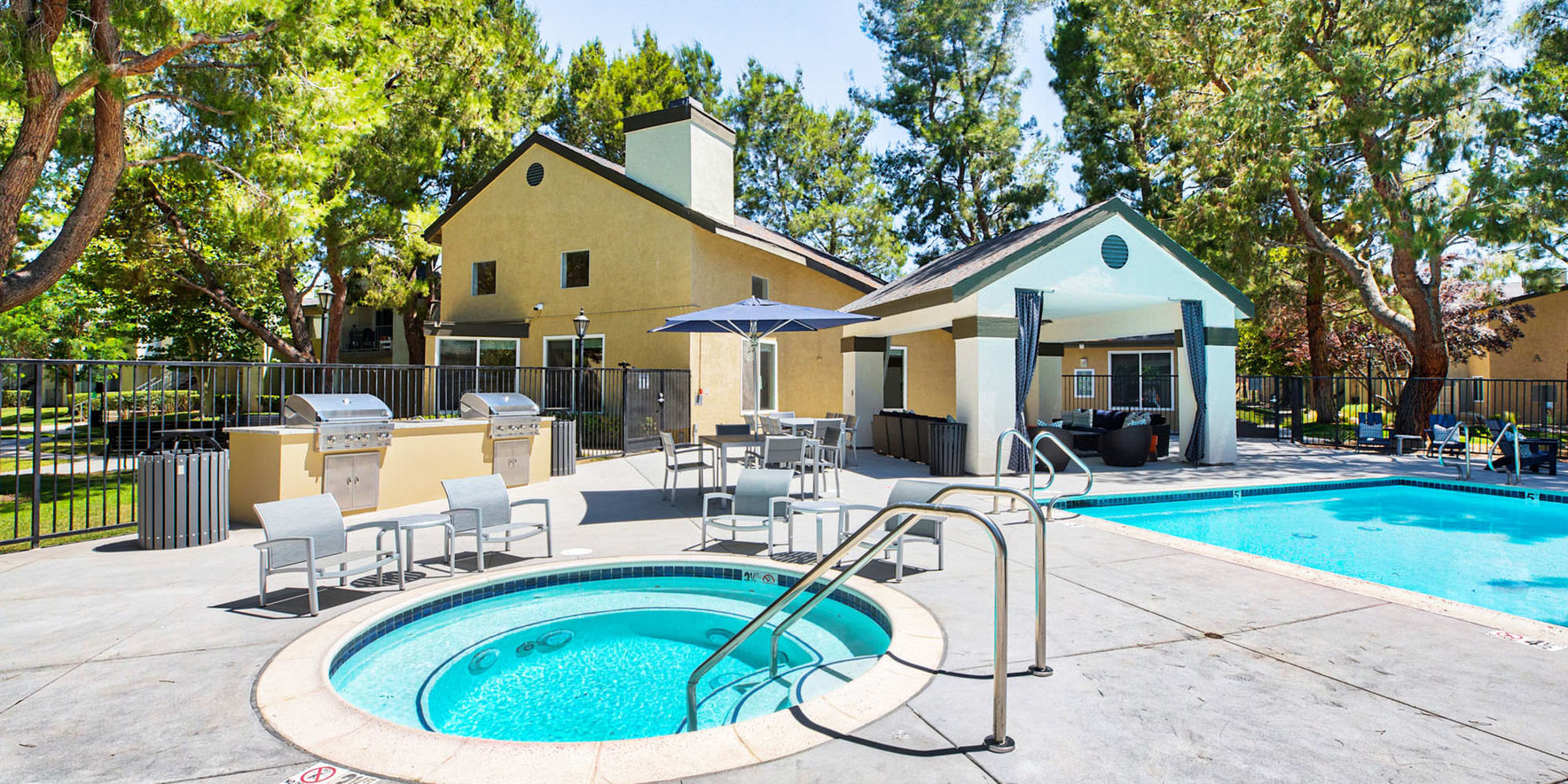 Gas barbecue grills near the spa and pool at Mountain Vista in Victorville, California