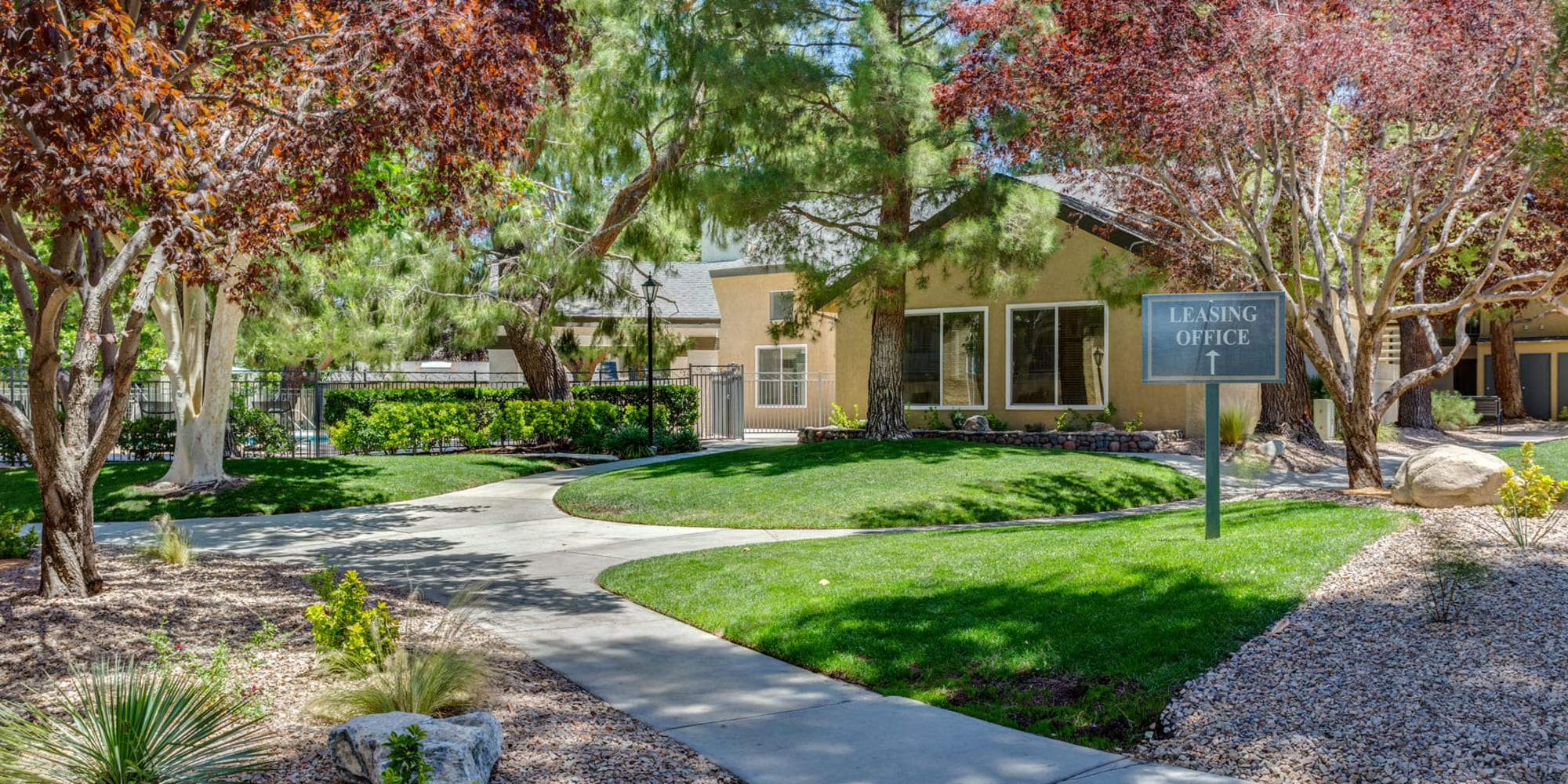 Beautifully groomed landscaping along pathways leading to the leasing office at Mountain Vista in Victorville, California