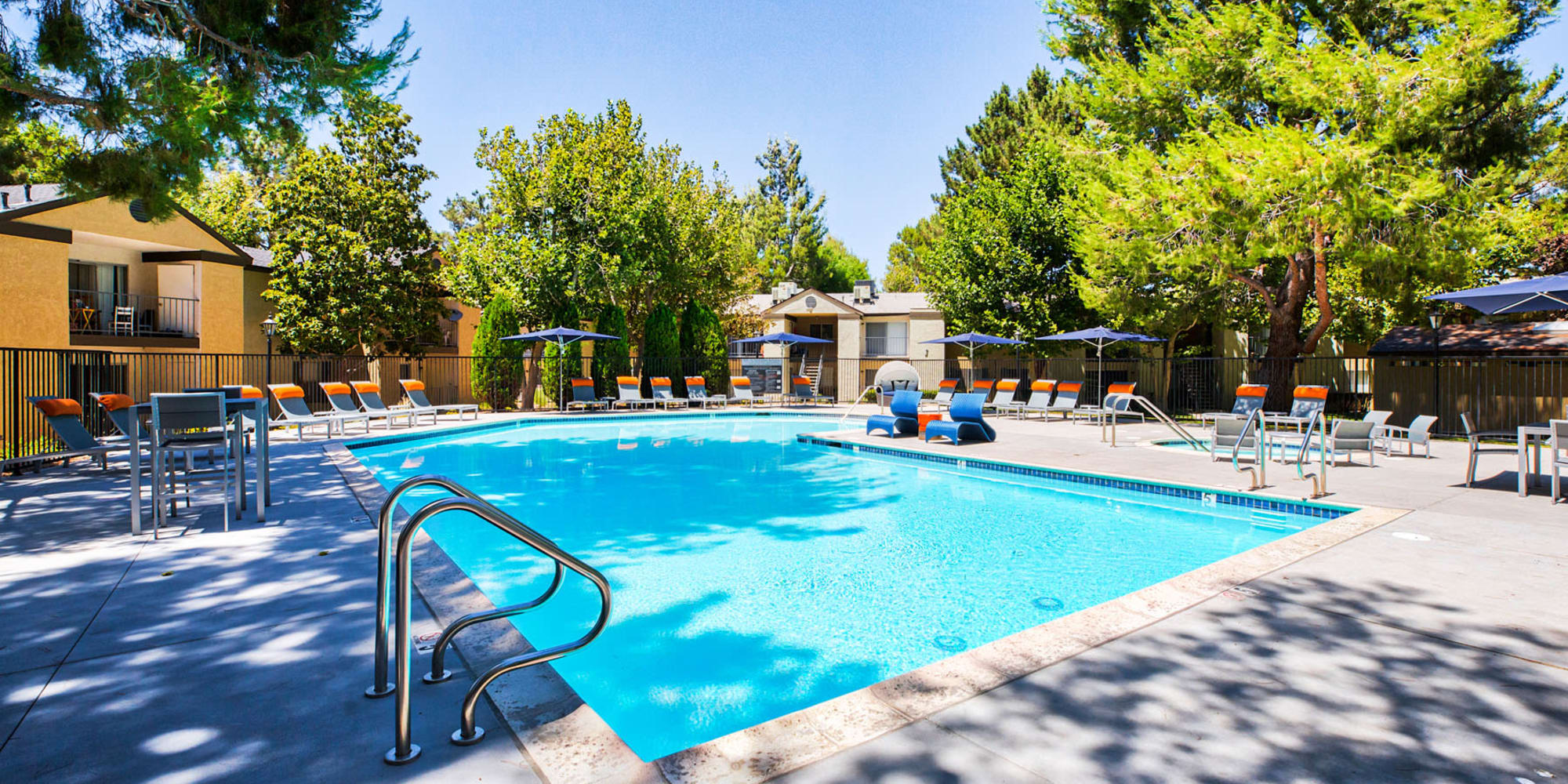Mature trees providing some shade at the pool at Mountain Vista in Victorville, California
