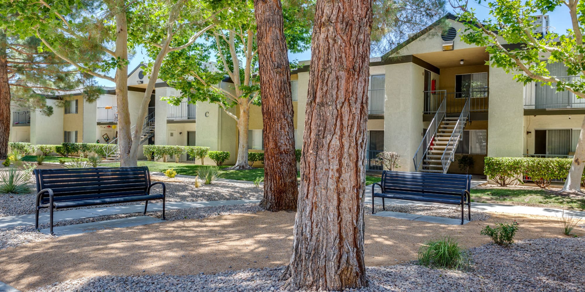 Park-like setting at a community courtyard at Mountain Vista in Victorville, California