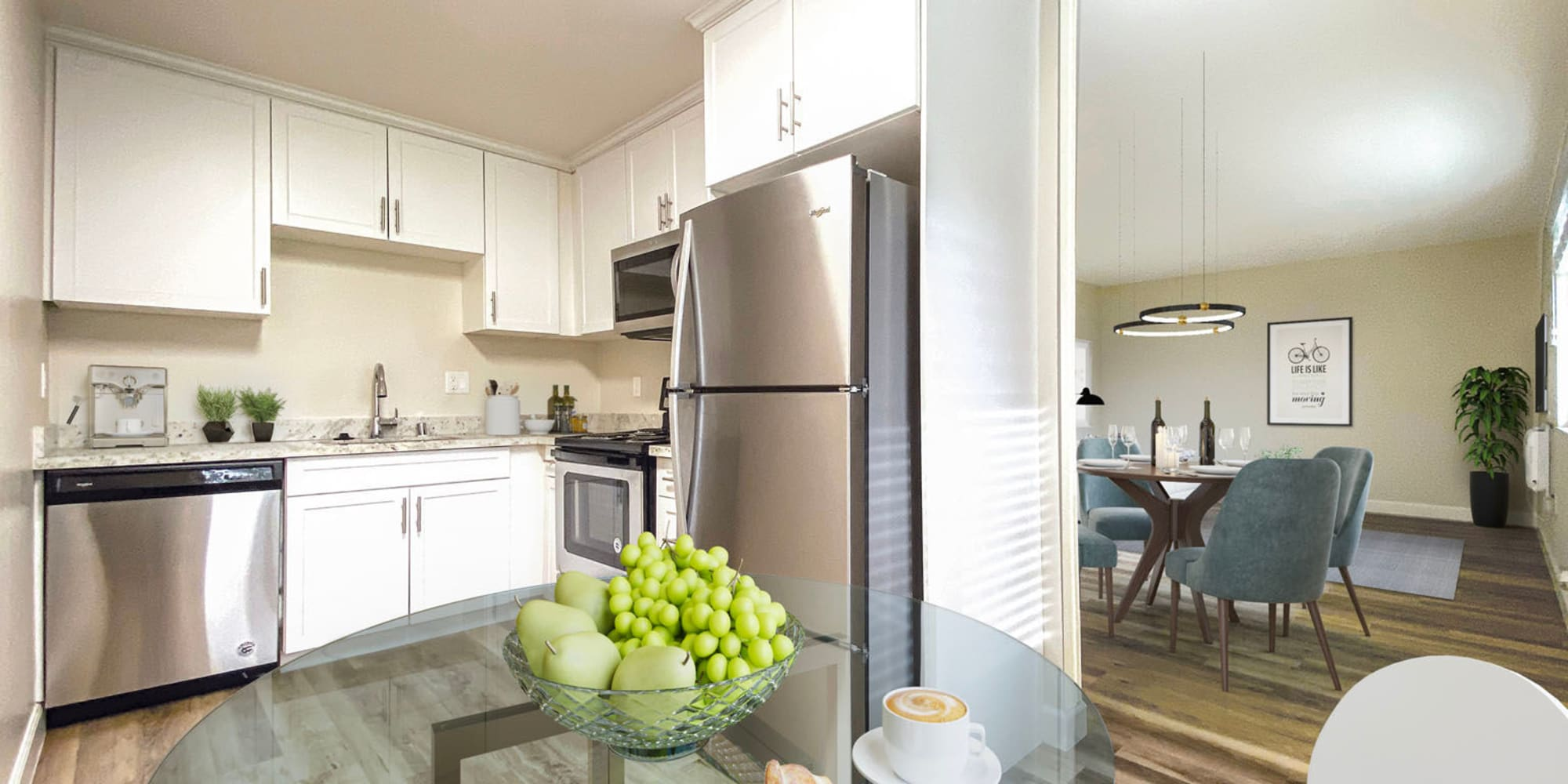 Model home's open-concept kitchen with hardwood flooring and stainless-steel appliances at Pleasanton Heights in Pleasanton, California