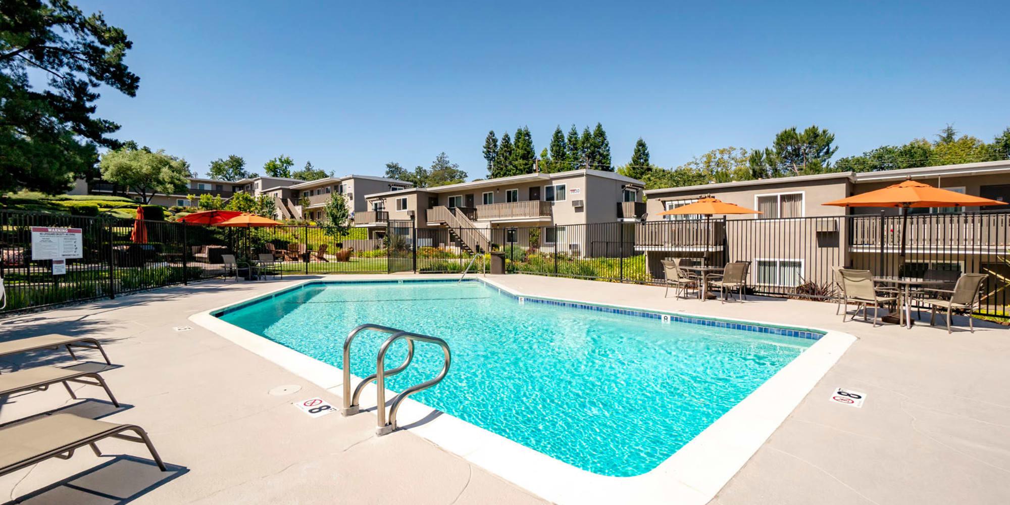 Shaded seating near the swimming pool at Pleasanton Heights in Pleasanton, California