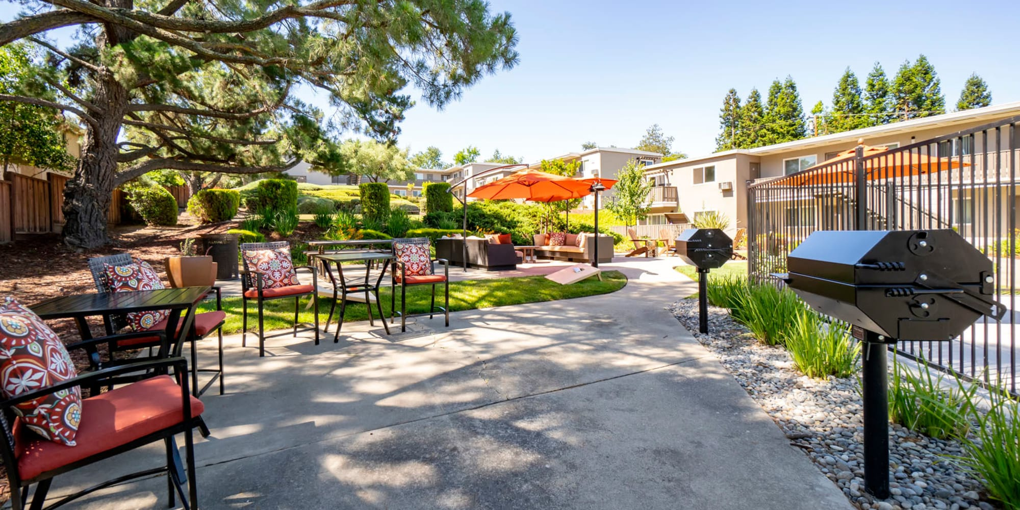 Peaceful outdoor lounge areas near barbecue stations at Pleasanton Heights in Pleasanton, California