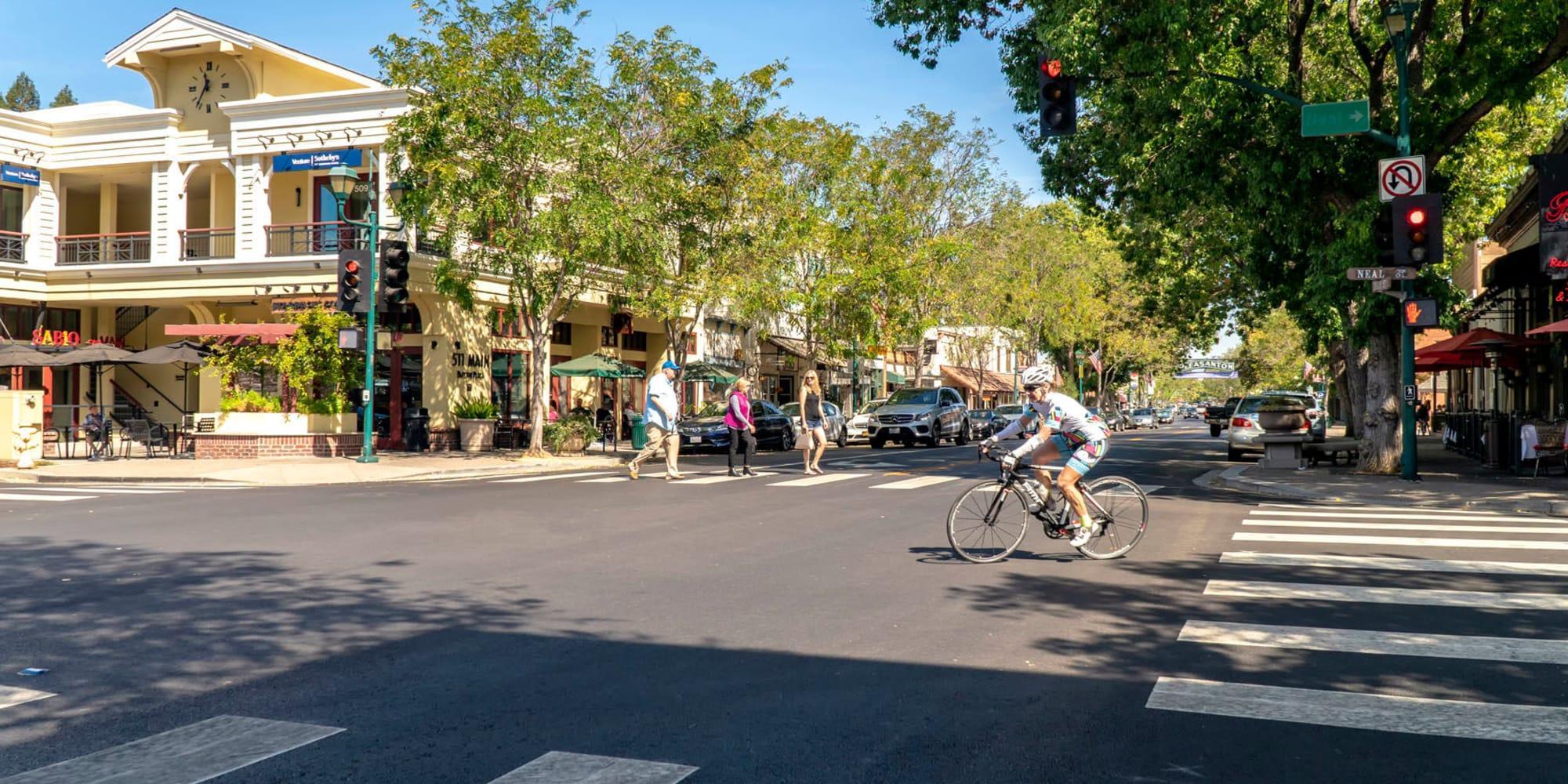 Resident biking to work through downtown Pleasanton, California, near Pleasanton Heights apartments