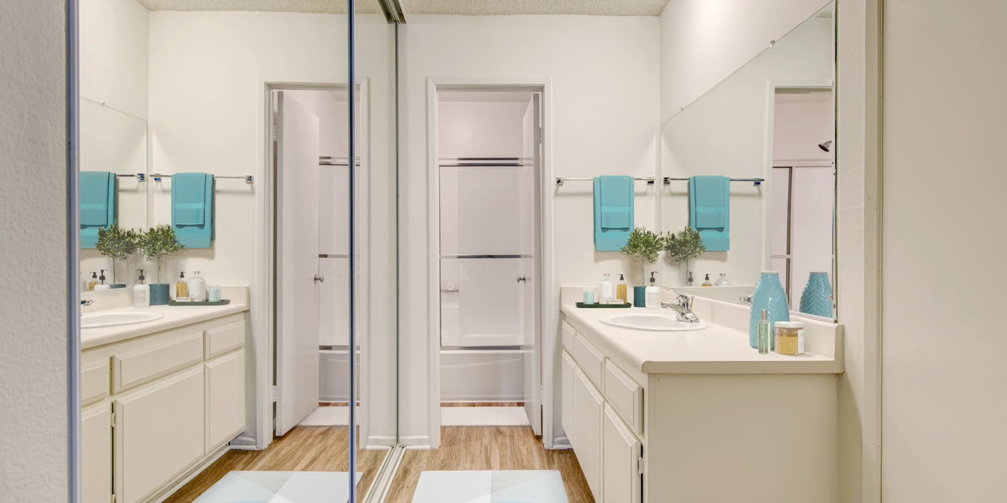 Mirrored closet doors in a model home's bathroom at Village Pointe in Northridge, California
