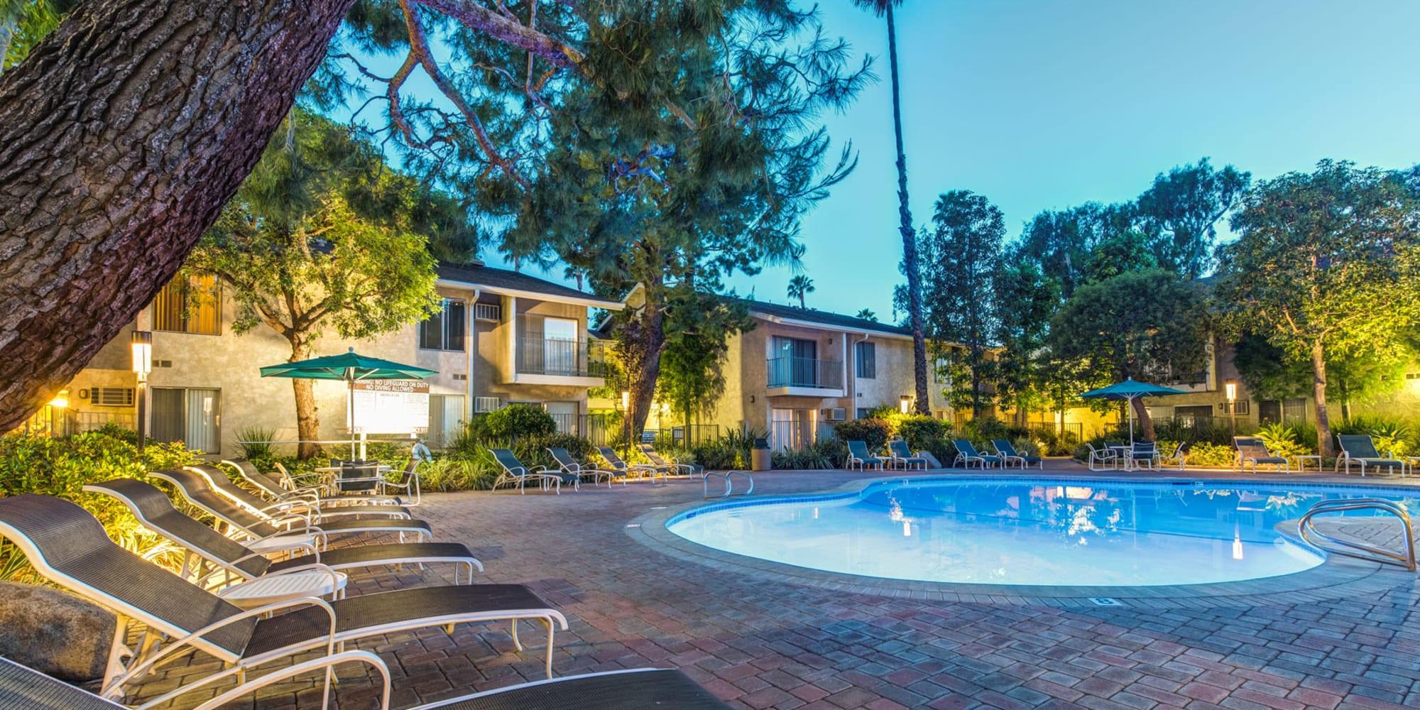 Underwater lights illuminating the pool at twilight at Village Pointe in Northridge, California