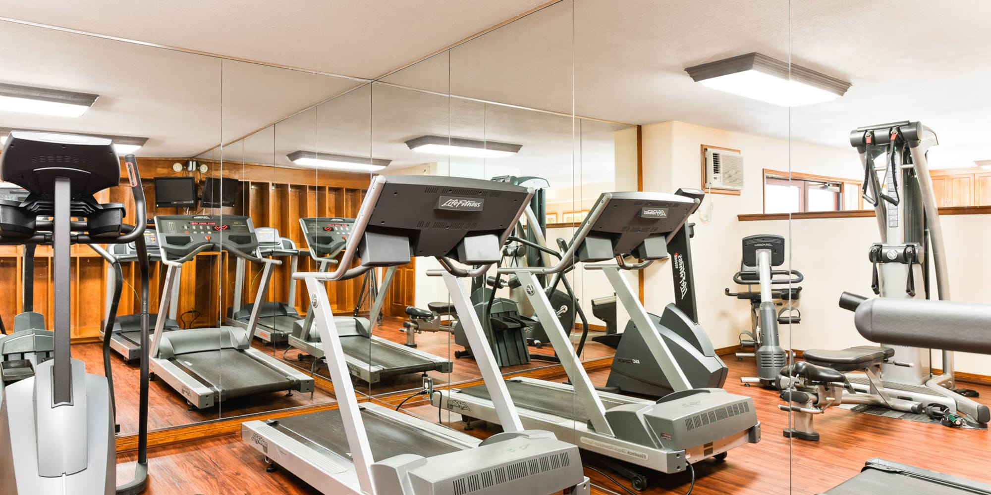 Cardio equipment and exercise machines in the fitness center at Village Pointe in Northridge, California