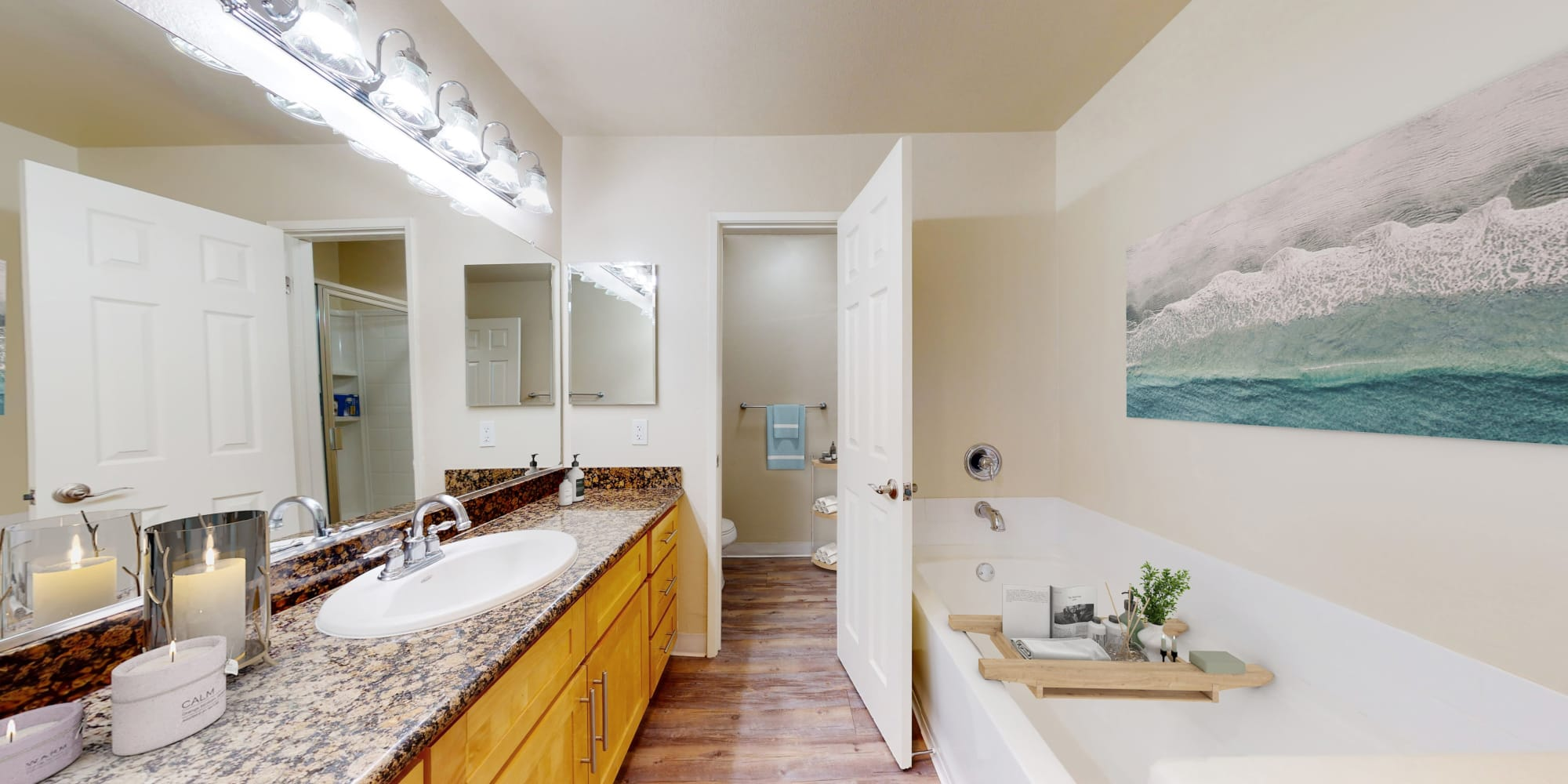 Bathroom with large vanity and soak tub in a one-bedroom apartment at Waters Edge at Marina Harbor in Marina del Rey, California