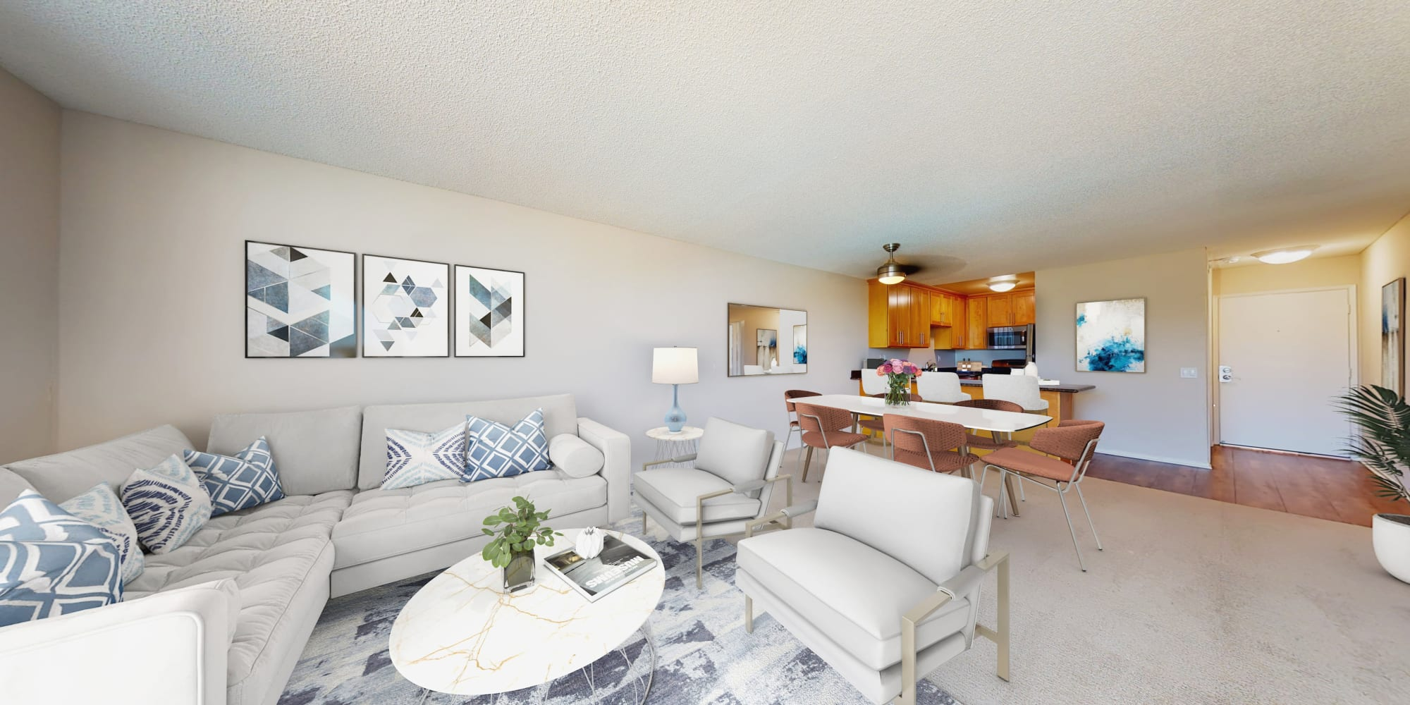 Open-concept living room in a one-bedroom apartment at Waters Edge at Marina Harbor in Marina del Rey, California