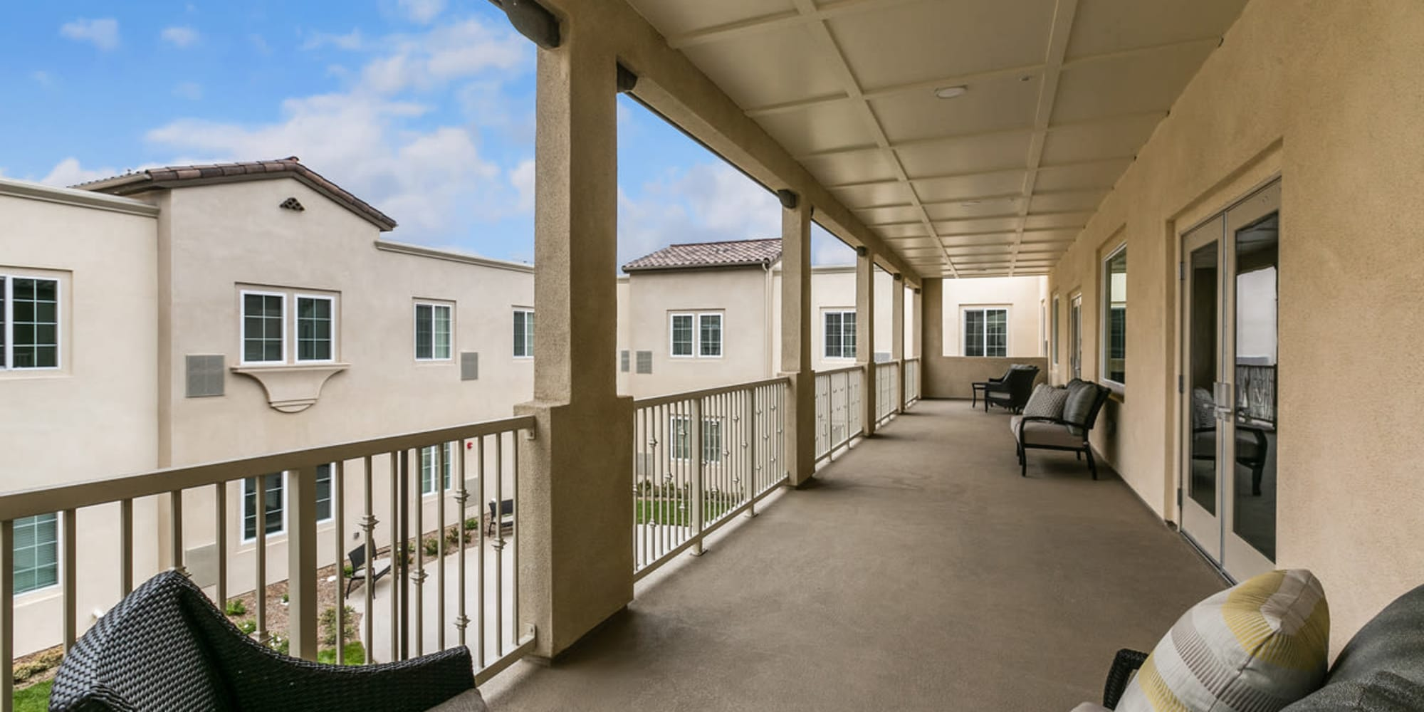 Photo of Estancia Senior Living - Balcony view from a resident bedroom