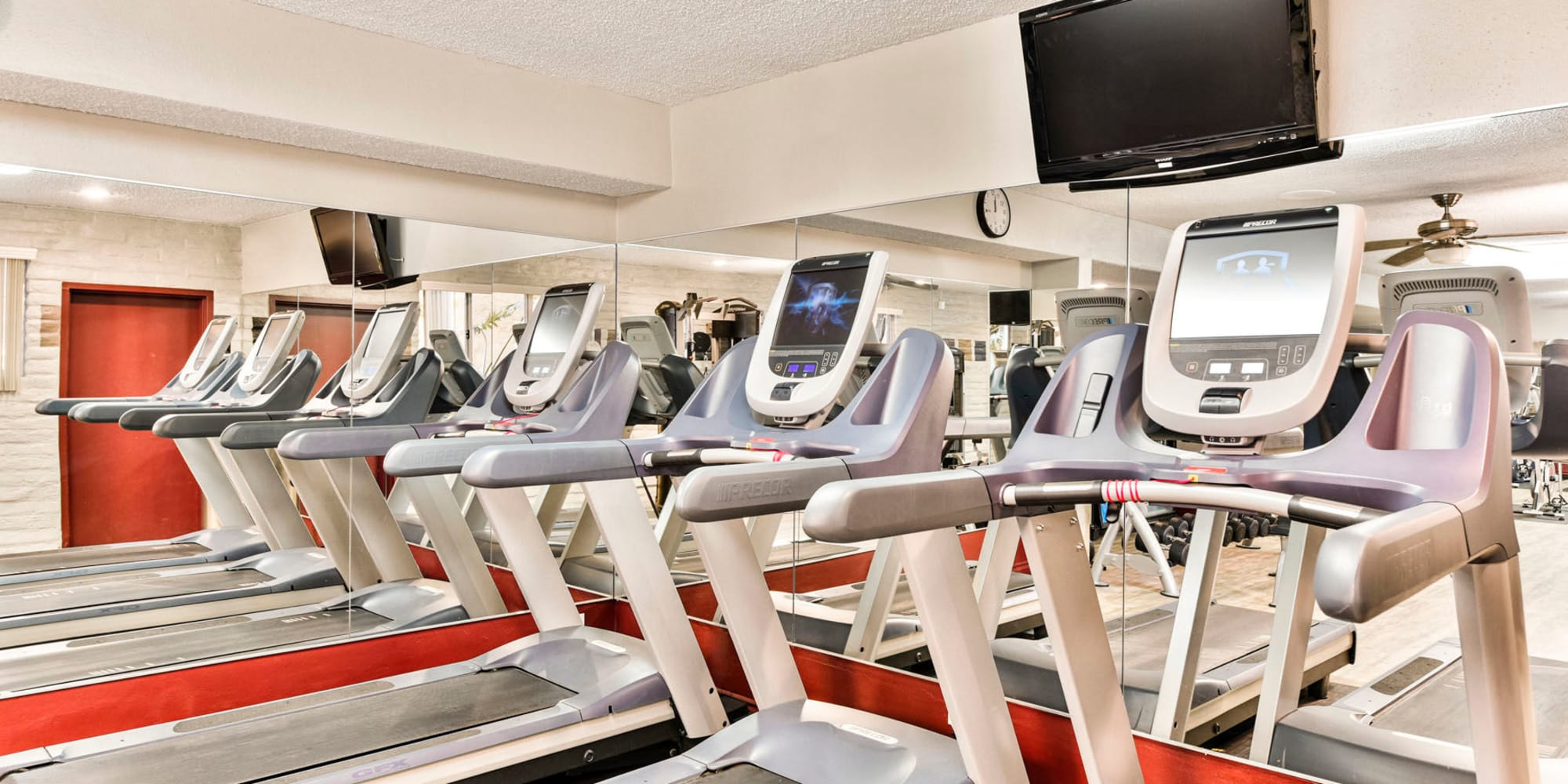Row of treadmills in the fitness center at Mediterranean Village in West Hollywood, California