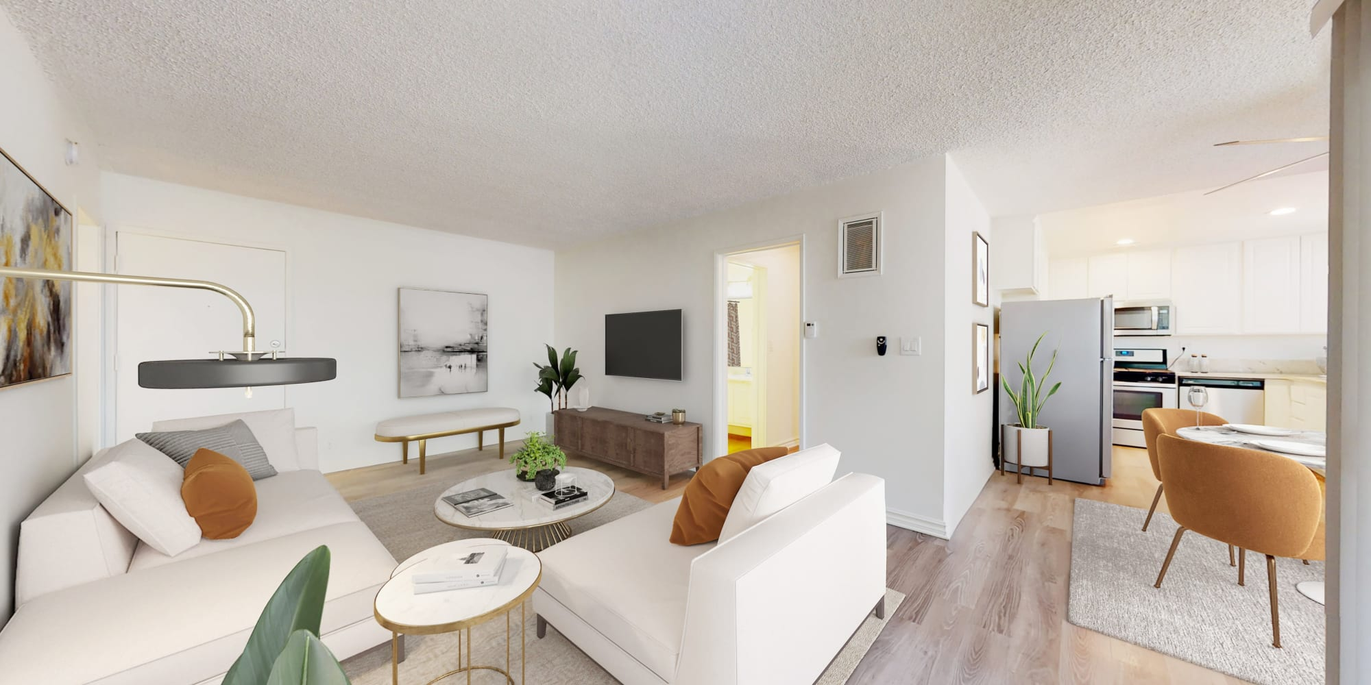 Living room and dining room in a two-bedroom apartment home at Sunset Barrington Gardens in Los Angeles, California