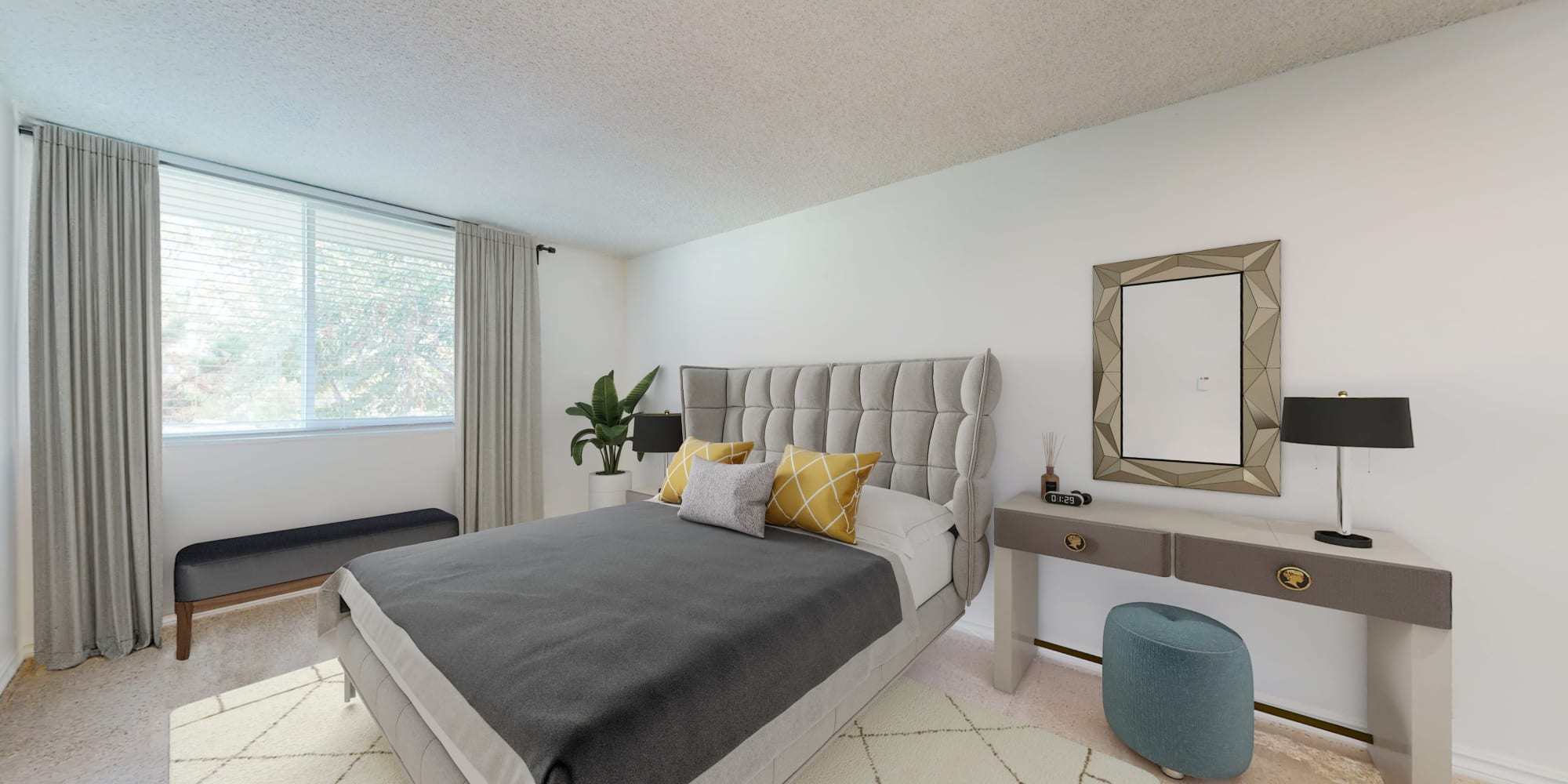 Spacious bedroom in a two-bedroom apartment home at Sunset Barrington Gardens in Los Angeles, California
