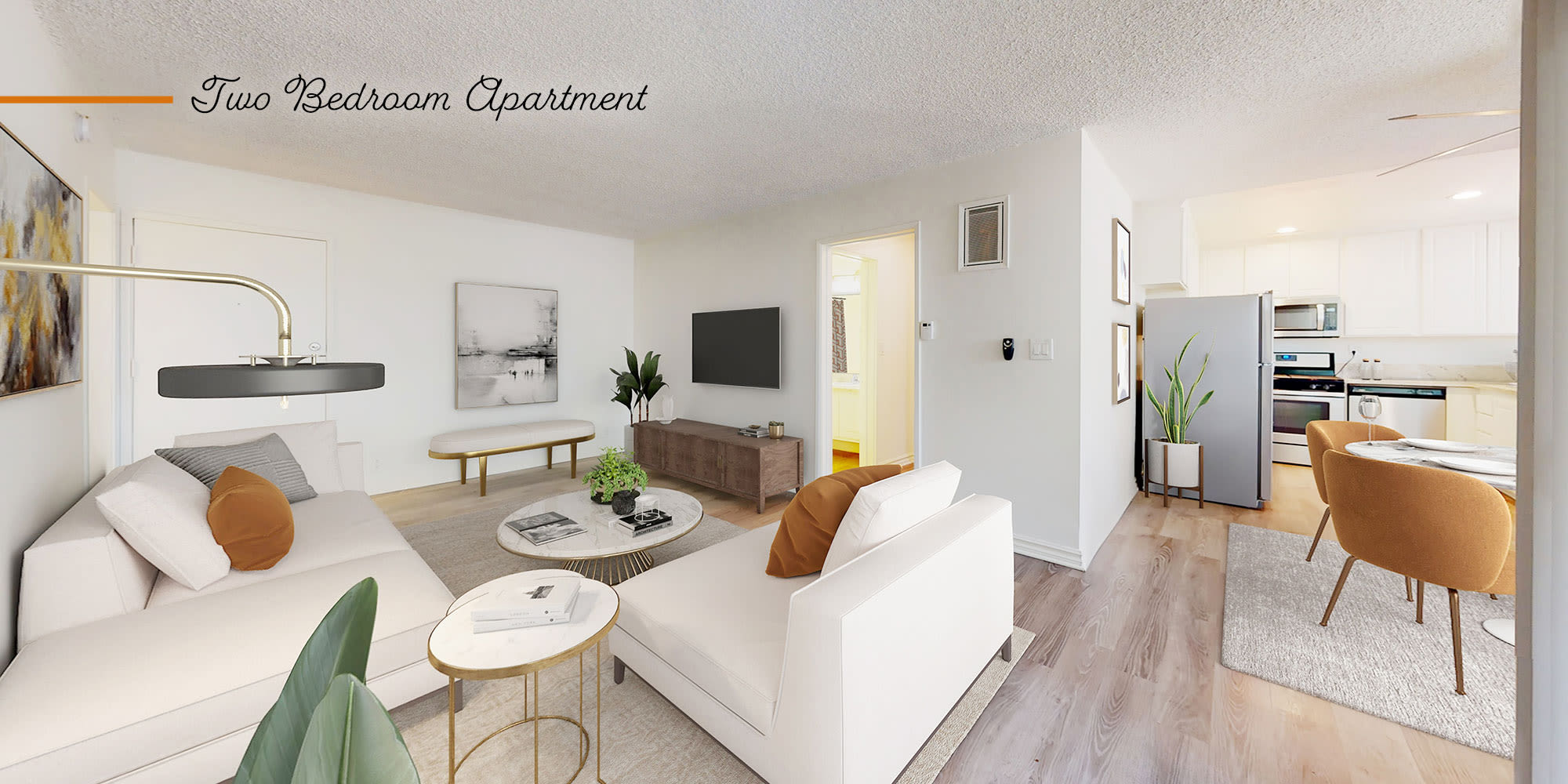 Living room and dining room in a two-bedroom apartment at Sunset Barrington Gardens in Los Angeles, California