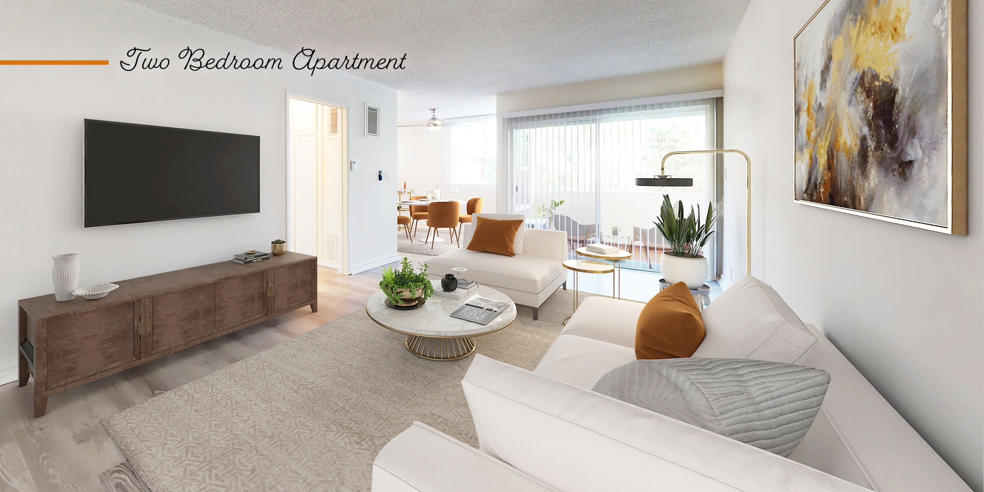 Living room and balcony in a two-bedroom apartment at Sunset Barrington Gardens in Los Angeles, California