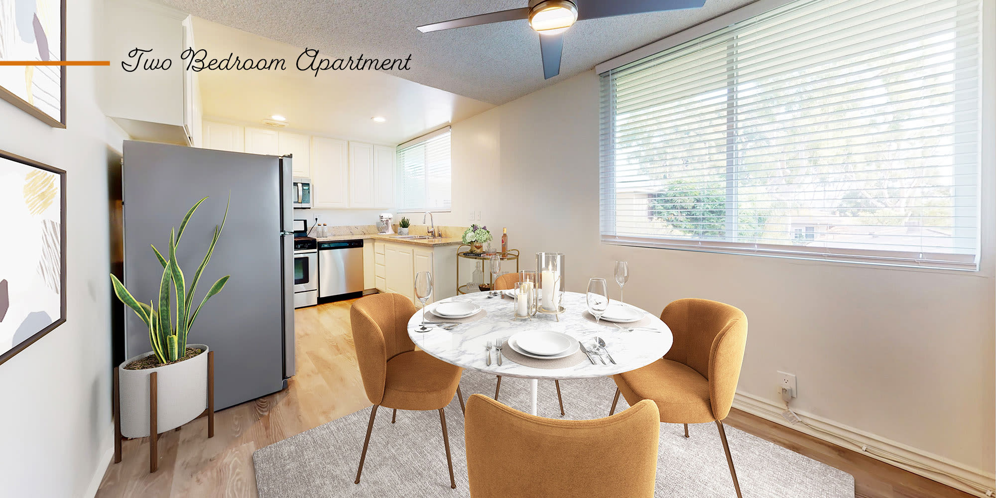 Dining room and kitchen in a two-bedroom apartment at Sunset Barrington Gardens in Los Angeles, California