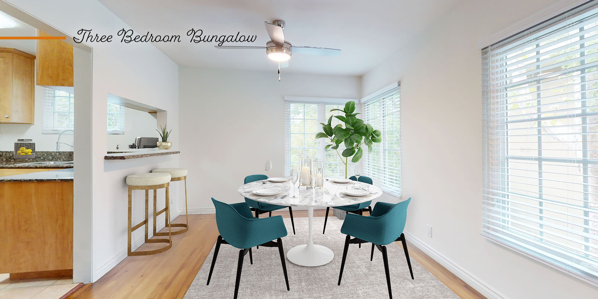 Spacious dining room with hardwood floors in a bungalow-style apartment at Sunset Barrington Gardens in Los Angeles, California