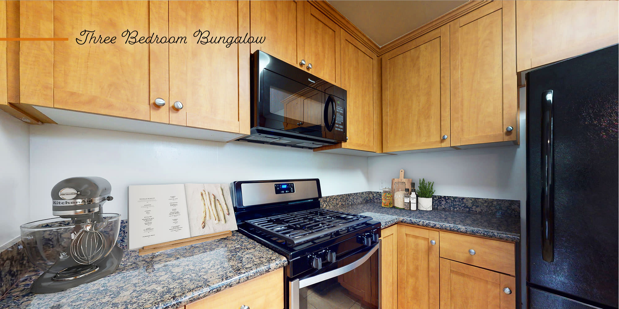 Kitchen in a bungalow-style apartment at Sunset Barrington Gardens in Los Angeles, California
