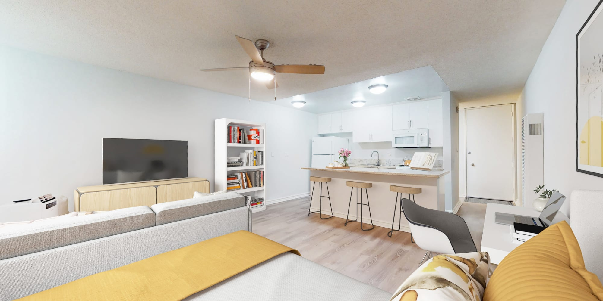 Studio model apartment view towards kitchenette space at Casa Granada in Los Angeles, California