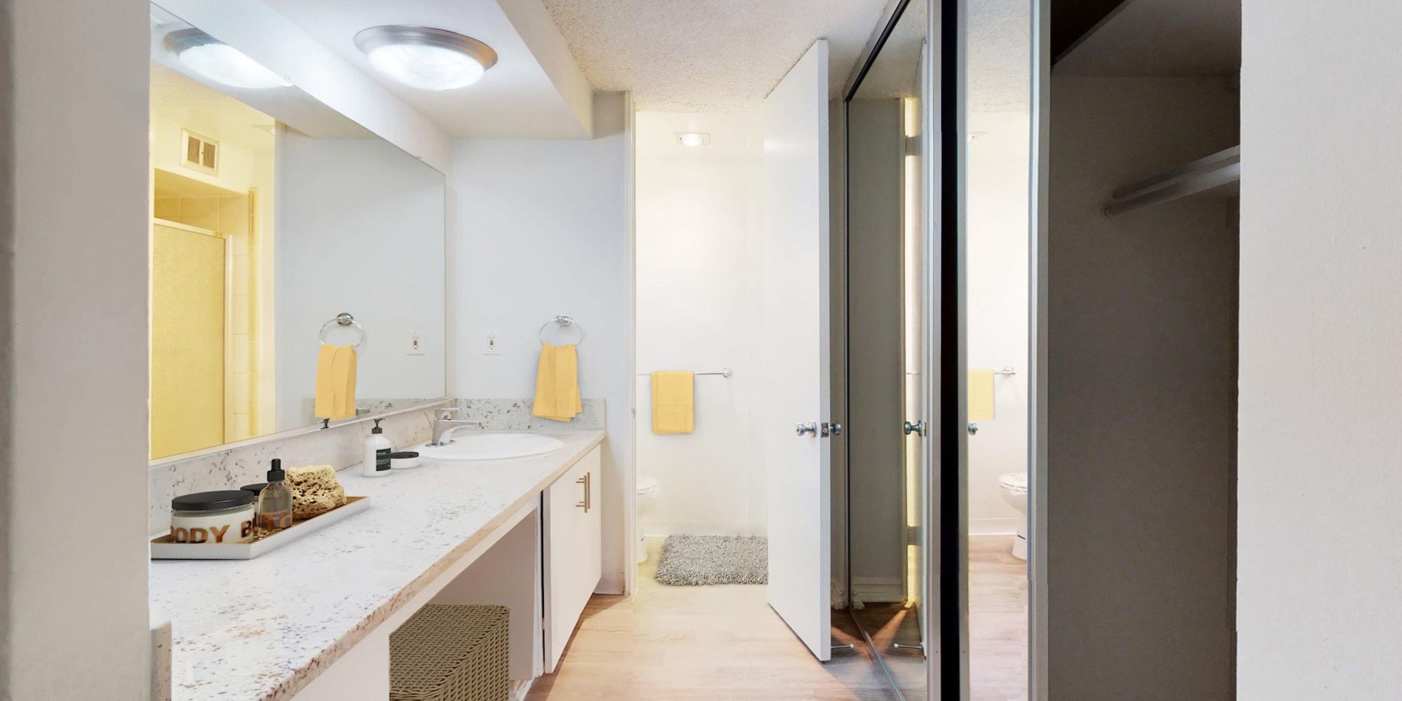 Bathroom view with spacious countertop and closets of a Studio model apartment at Casa Granada in Los Angeles, California