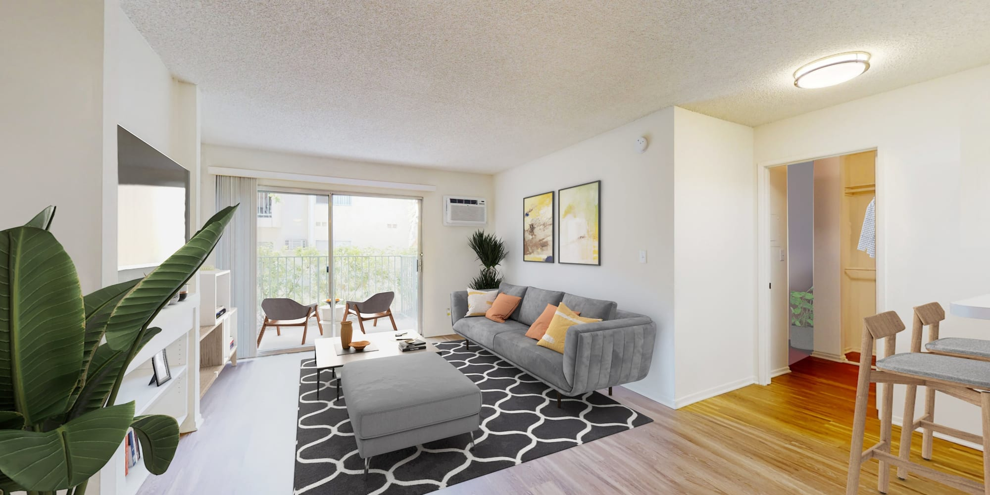 Open-concept one-bedroom apartment's living room at Village Pointe in Northridge, California