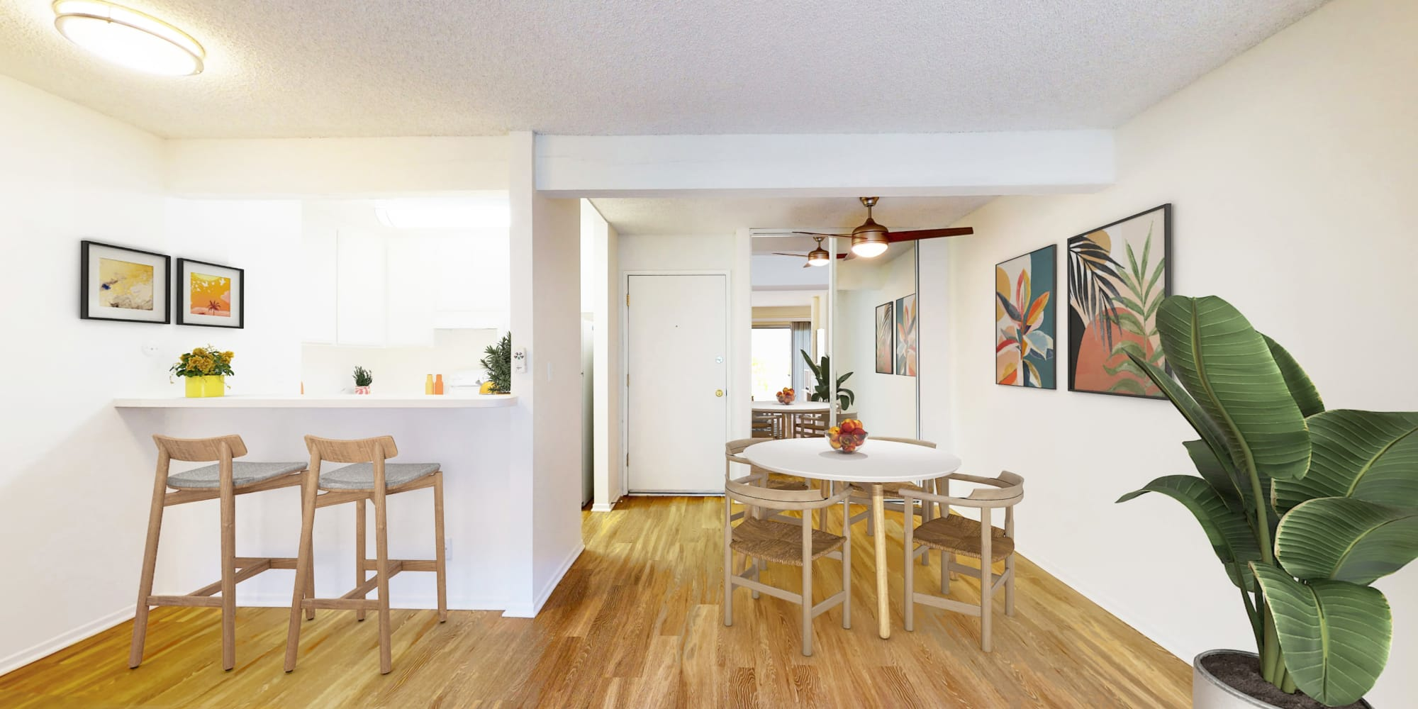 One-bedroom apartment's living and dining areas at Village Pointe in Northridge, California