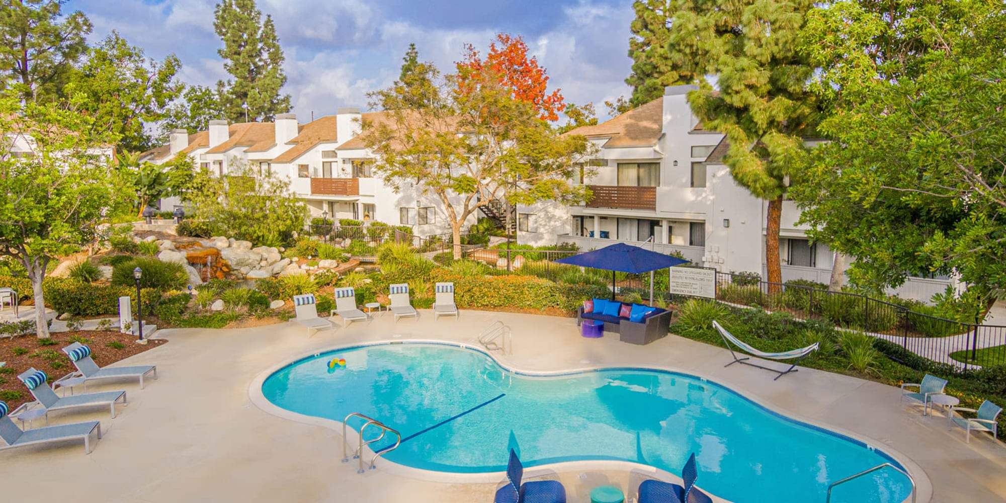 Early fall afternoon with leaves beginning to change color at the swimming pool area at Sendero Huntington Beach in Huntington Beach, California