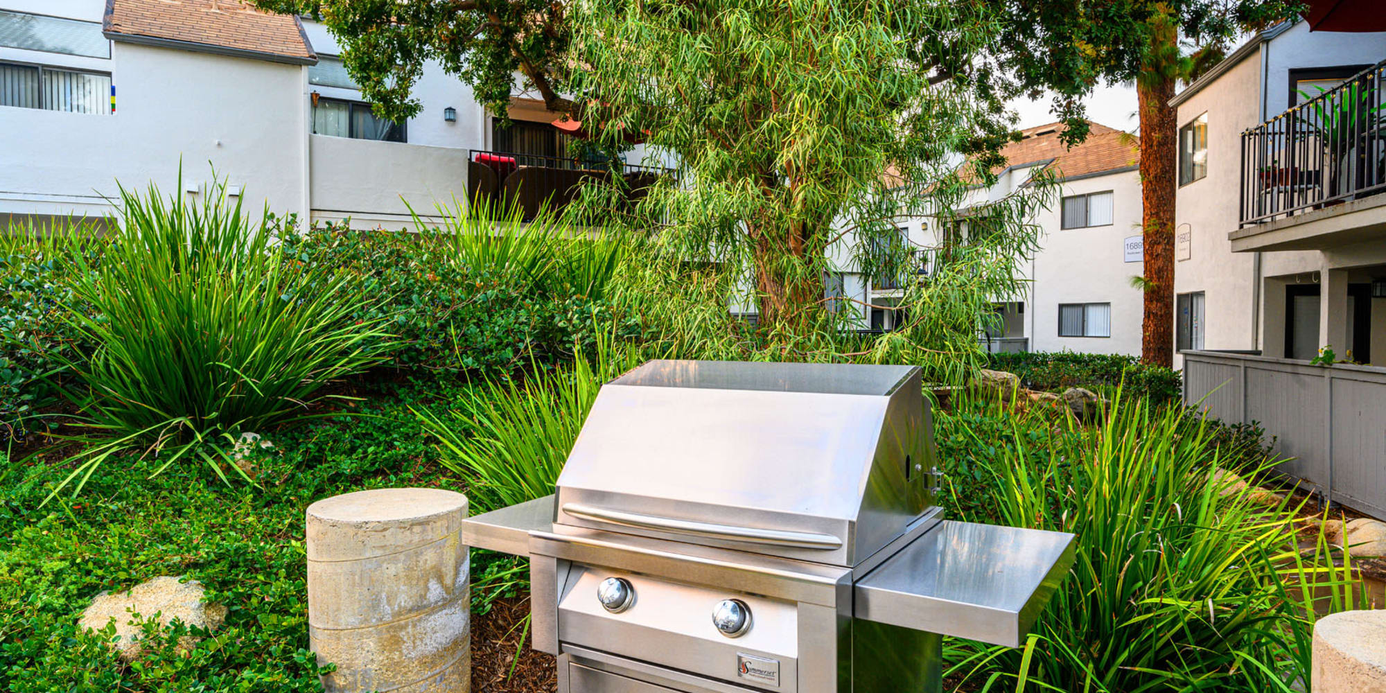 Gas grill at the barbecue area at Sendero Huntington Beach in Huntington Beach, California