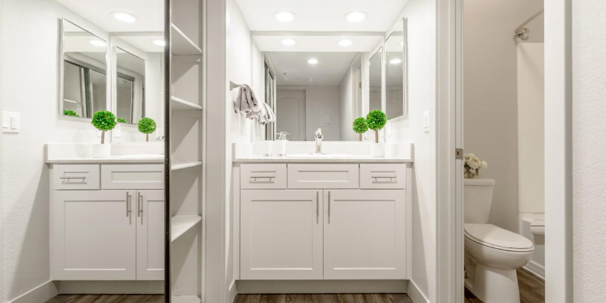 Recently remodeled model home's bathroom with a quartz countertop at Sendero Huntington Beach in Huntington Beach, California