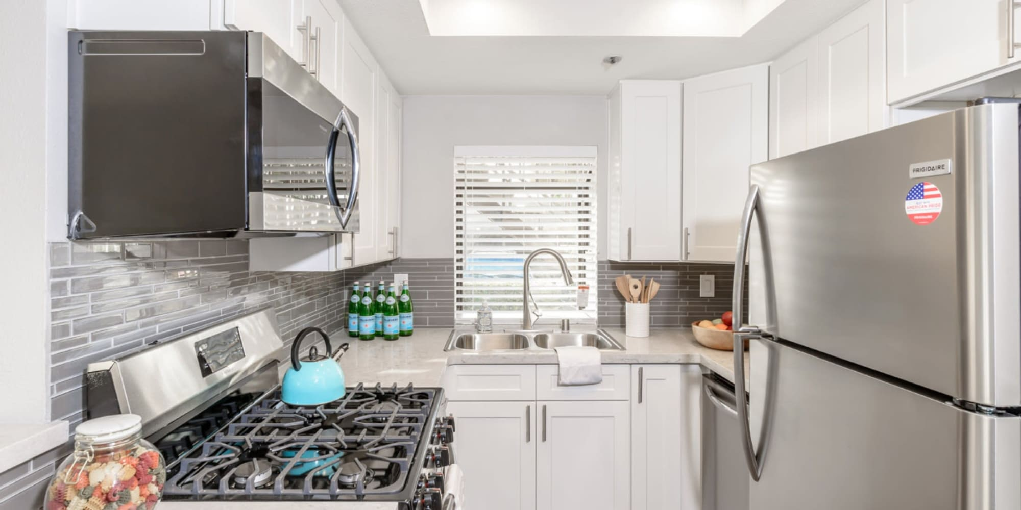 Very modern looking kitchen with new appliances at Sendero Huntington Beach in Huntington Beach, California
