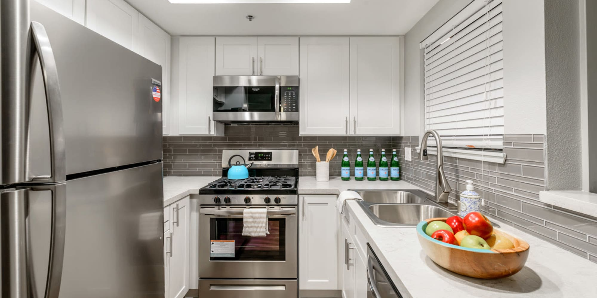 Stainless-steel appliances in a newly remodeled model home's kitchen at Sendero Huntington Beach in Huntington Beach, California