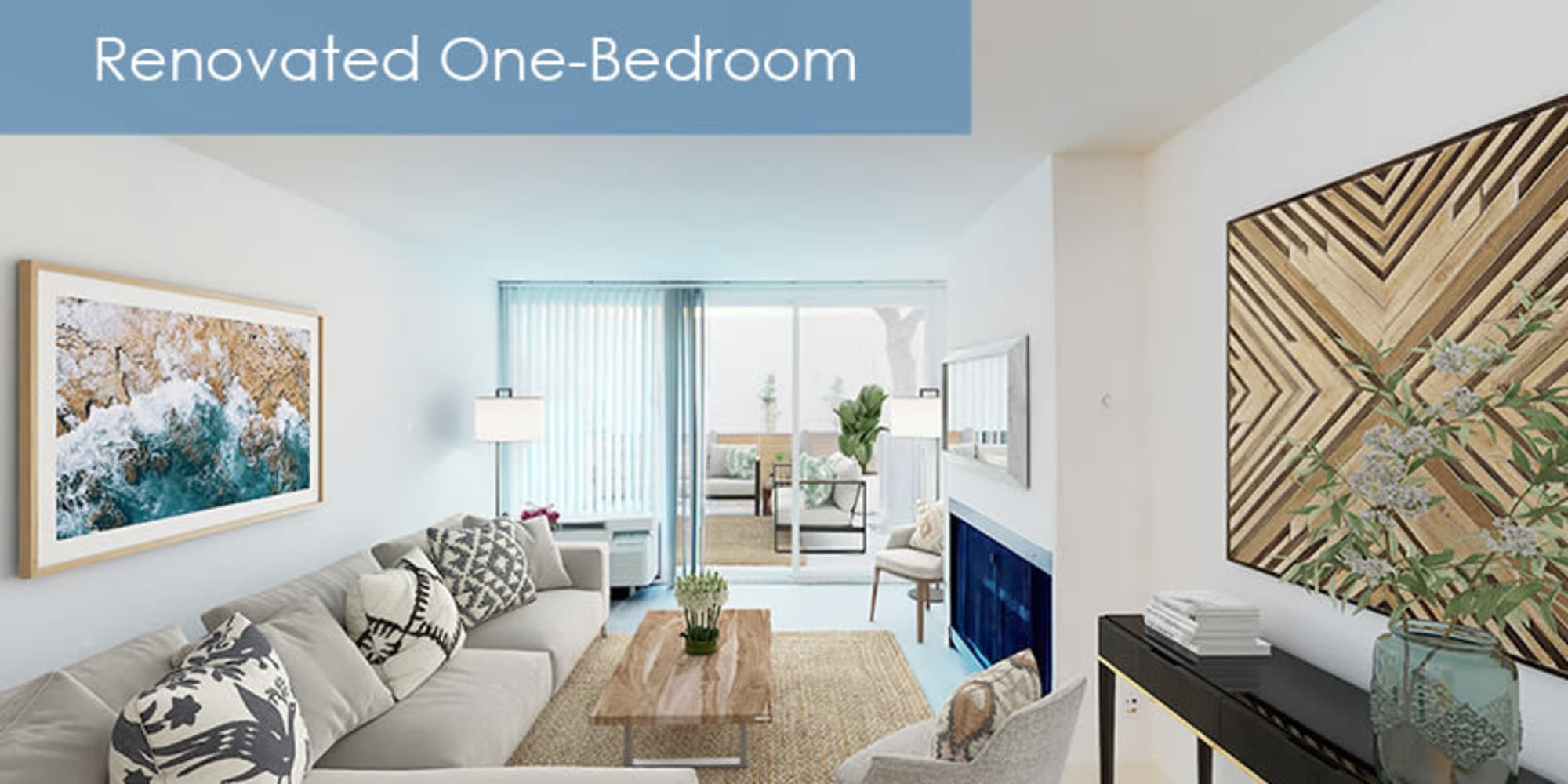 renovated living room with large windows at The Meadows in Culver City, California