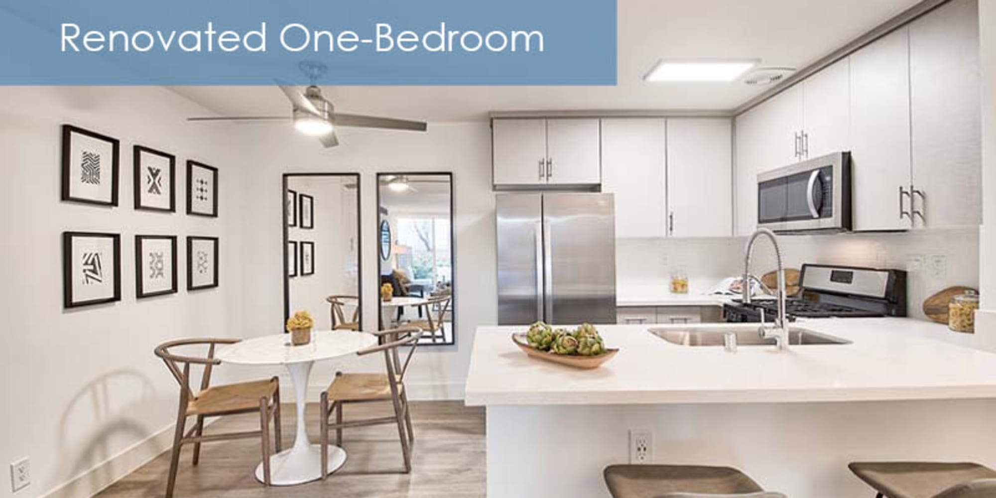renovated kitchen with a breakfast bar at The Meadows in Culver City, California