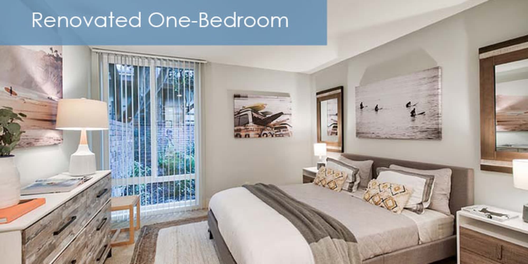 renovated bedroom with a large window at The Meadows in Culver City, California