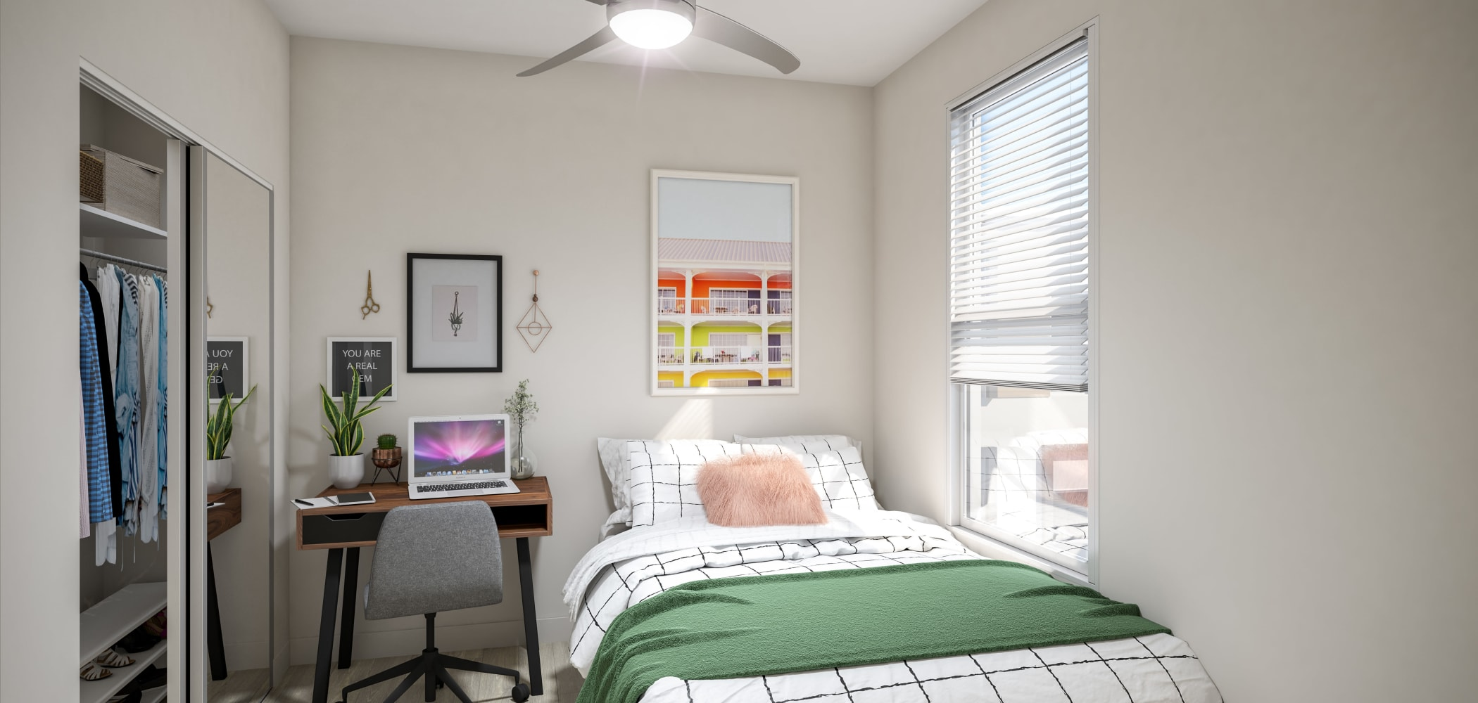 Spacious bedroom with a ceiling fan at UNCOMMON Raleigh in Raleigh, North Carolina
