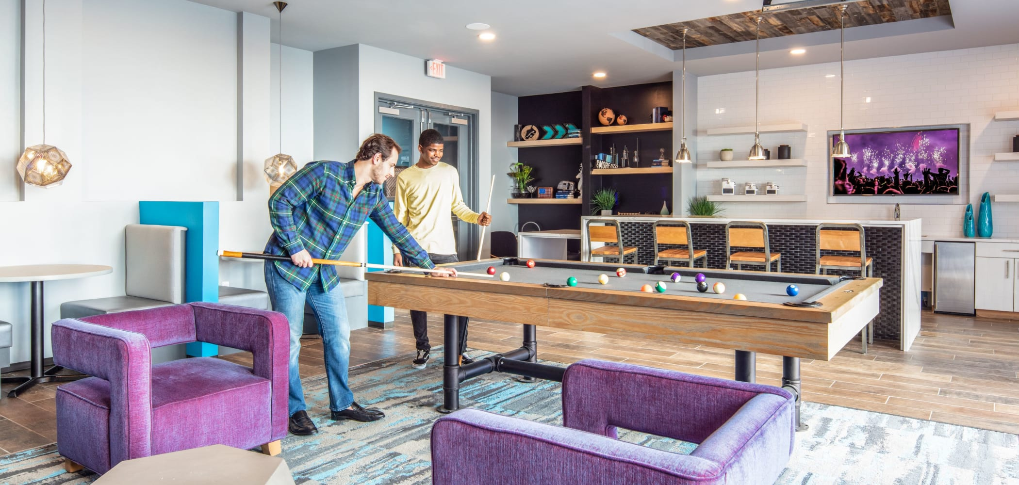 Game room with a billiards table at UNCOMMON Columbus in Columbus, Ohio