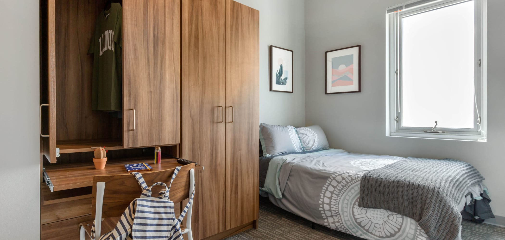Bright bedroom at HERE Champaign in Champaign, Illinois